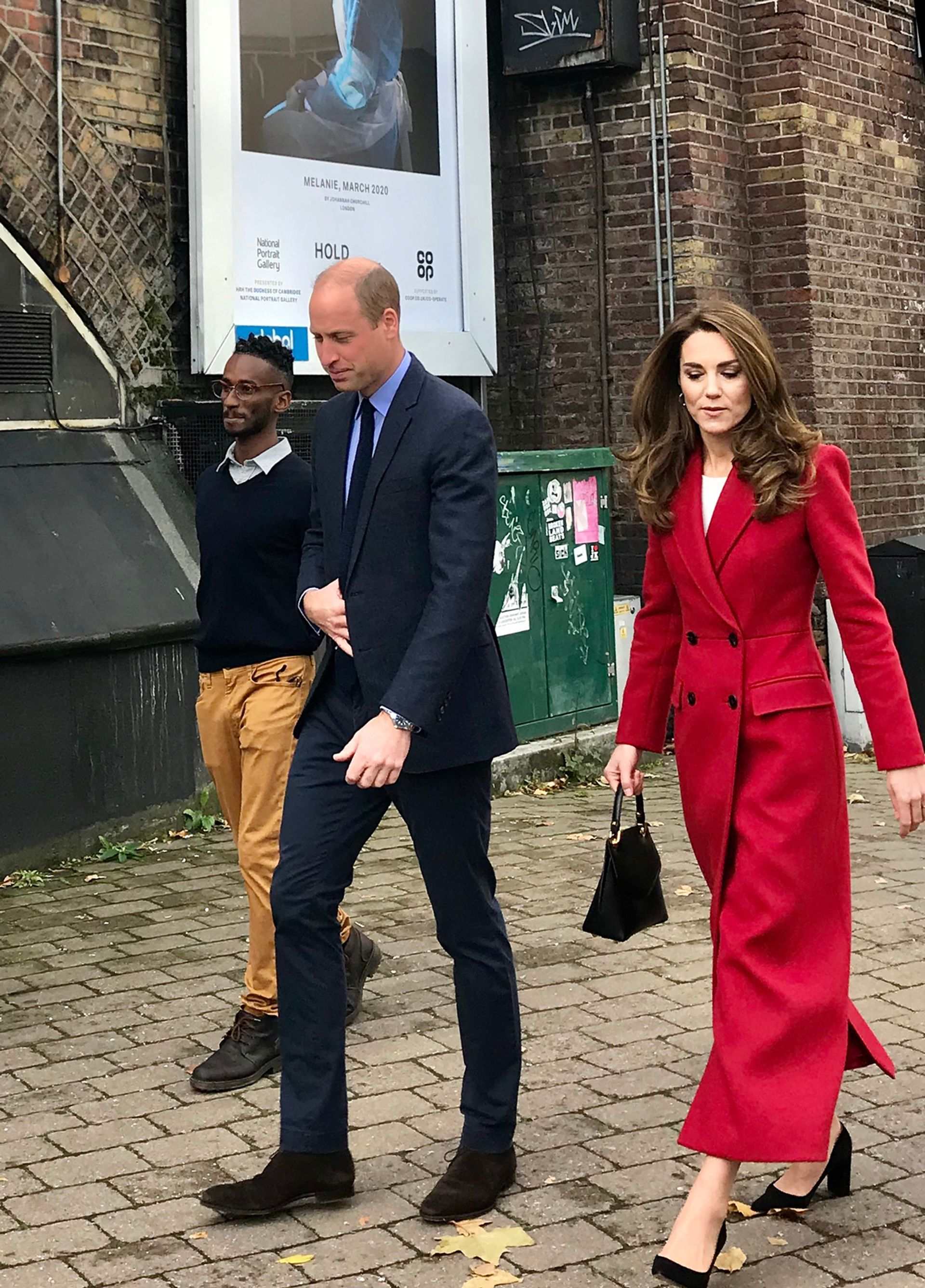 The Duke and Duchess of Cambridge with PhD student and volunteer Sami Massalami Ayad