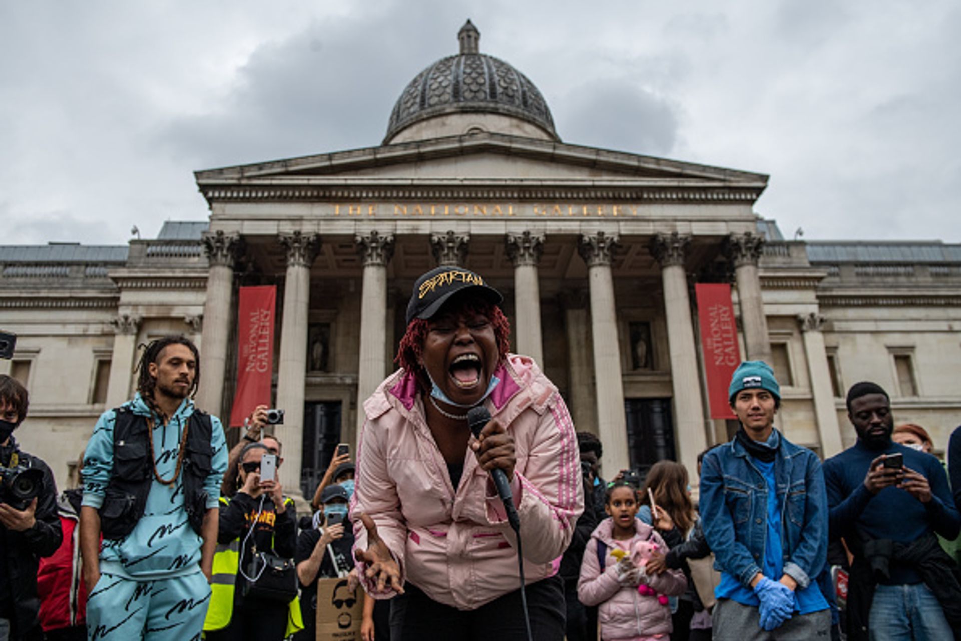 A Black Lives Matter supporter sings to crowds who marched with her in front of the National Gallery in Trafalgar Square on 12 June in London. Photo by Chris J Ratcliffe/Getty Images