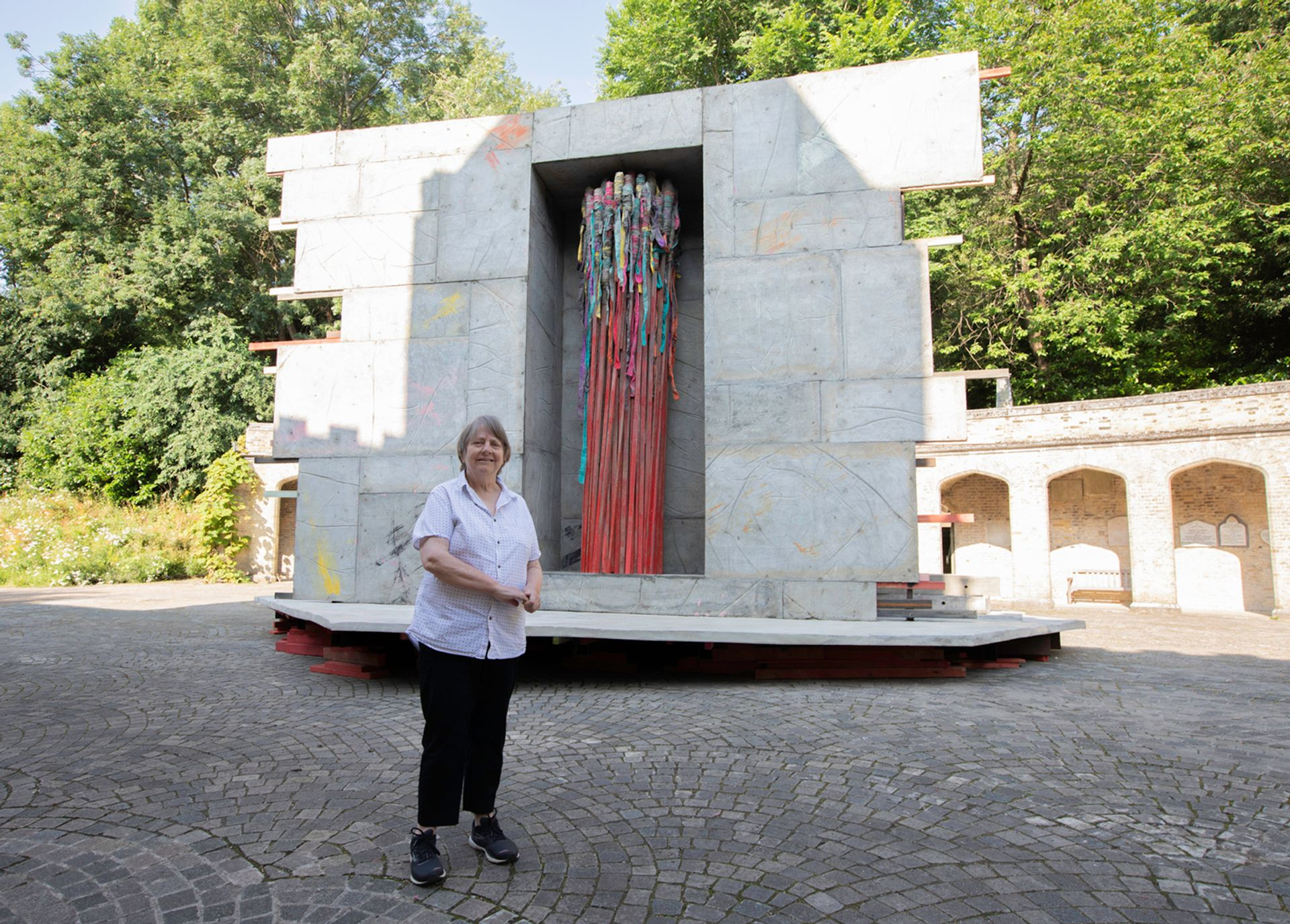 Phyllida Barlow in front of Act (2021) at Highgate Cemetery Photo: David Owens