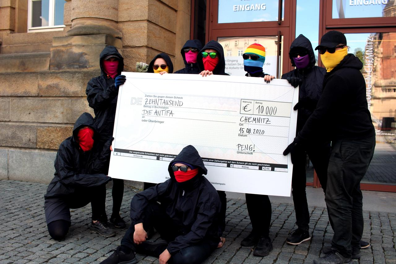 Peng Collective with a €10,000 cheque written out to antifa, an anti-fascist protest movement Photo: Peng Collective