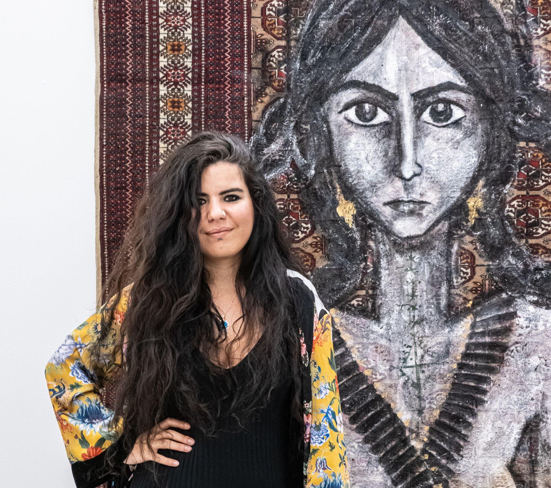 Zehra Dogan at her exhibition Frenetic Standstill in Turin © OKNOstudio