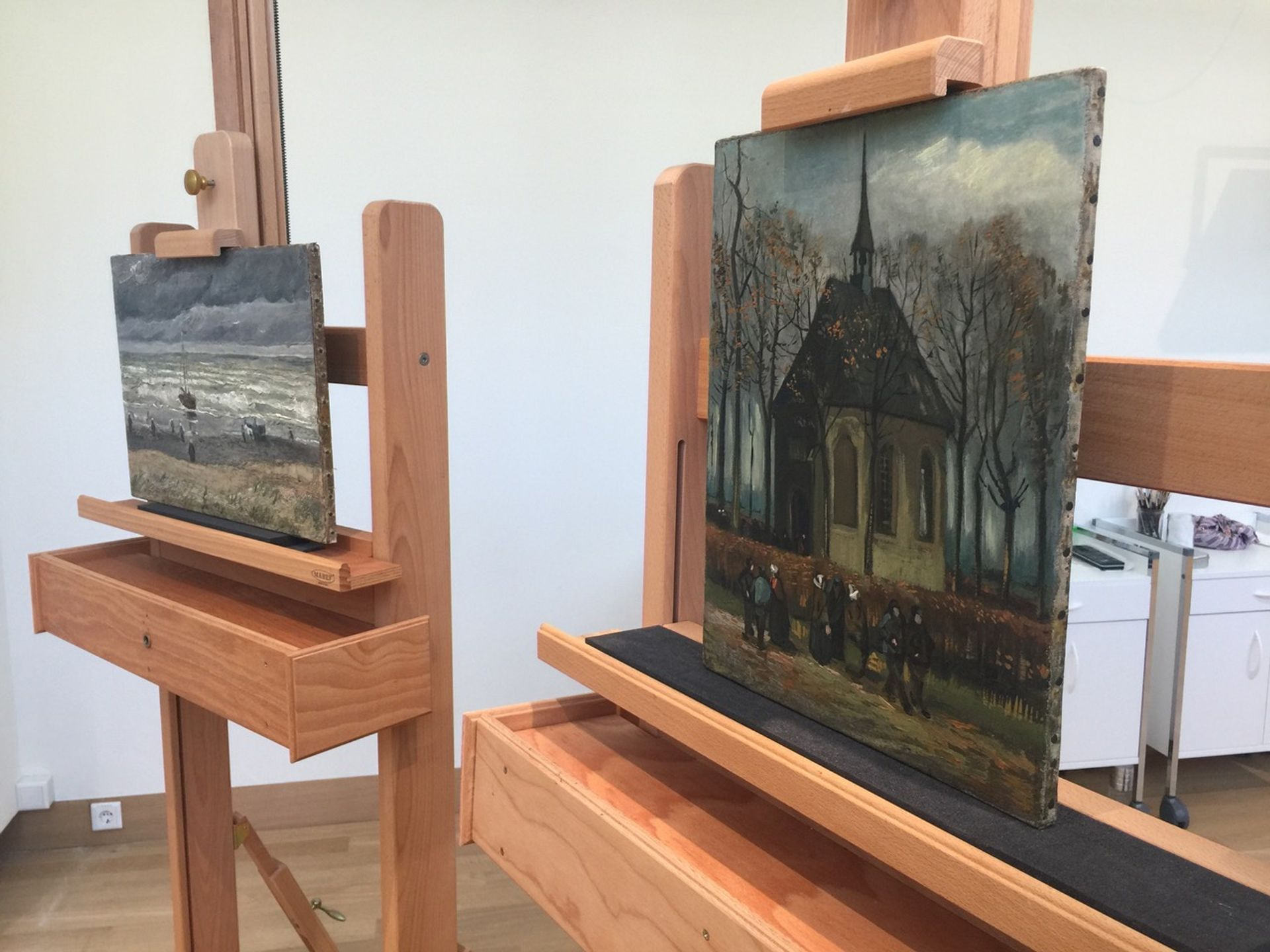 View of the Sea at Scheveningen (1882) and Congregation leaving the Reformed Church in Nuenen (1884-85) in the conservation studio, Van Gogh Museum, Amsterdam, on 16 April Photo: Martin Bailey