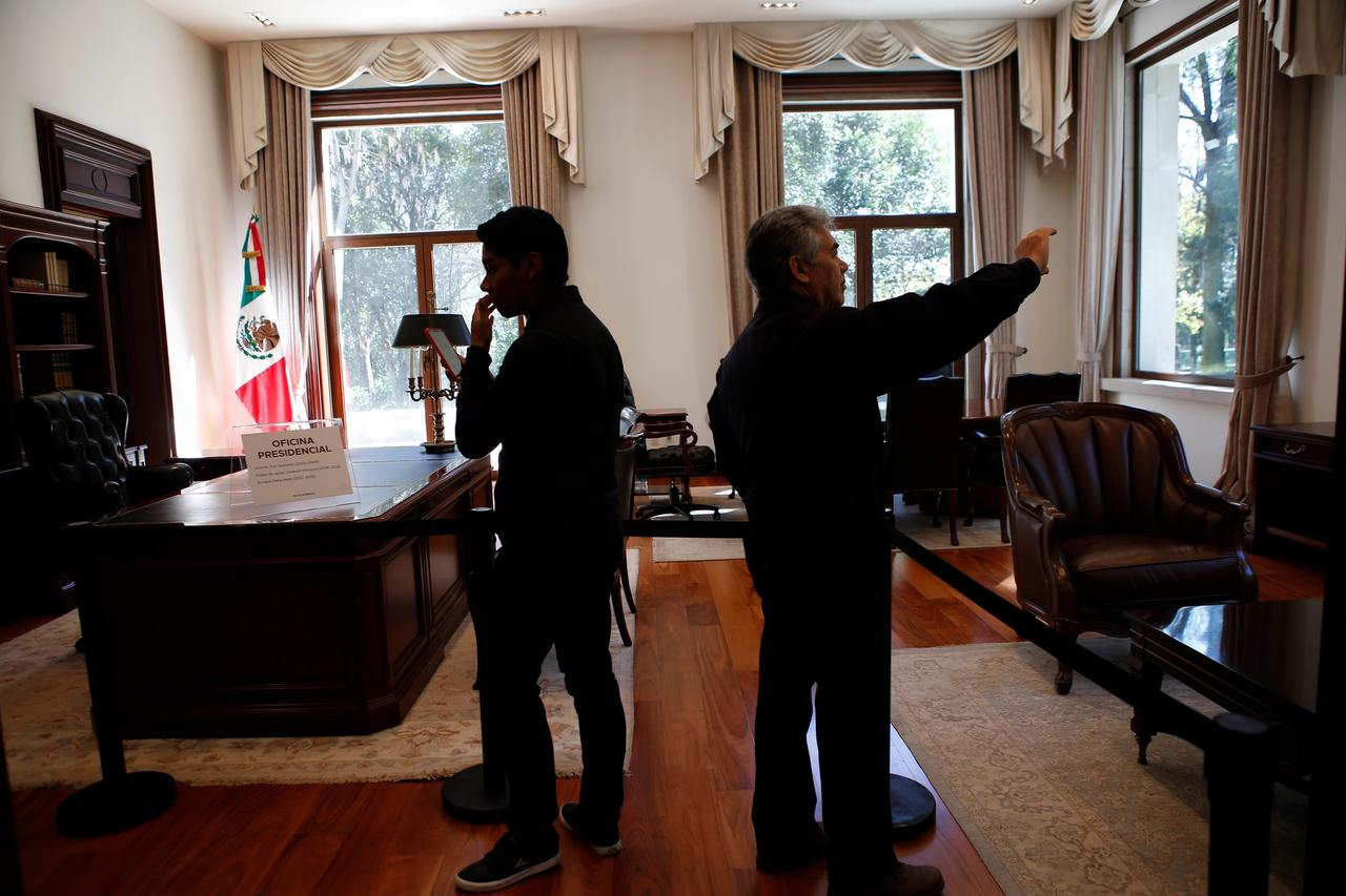 Visitors take photos inside the former presidential office at Los Pinos in Mexico City AP Photo/Ginnette Riquelme