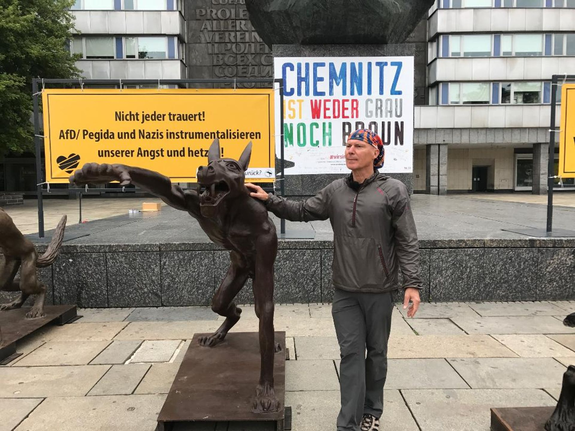 Rainer Opolka with his wolf statue in Chemnitz Courtesy of the artist