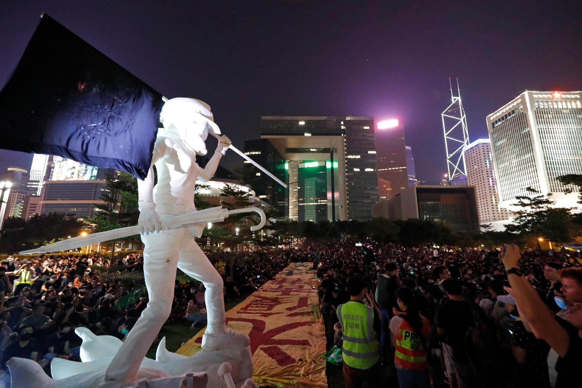 Protestors gather near the Lady Liberty statue, depicting a protestor, at Tamar Park in Hong Kong, Saturday, 28 September 2019 AP Photo/Vincent Thian