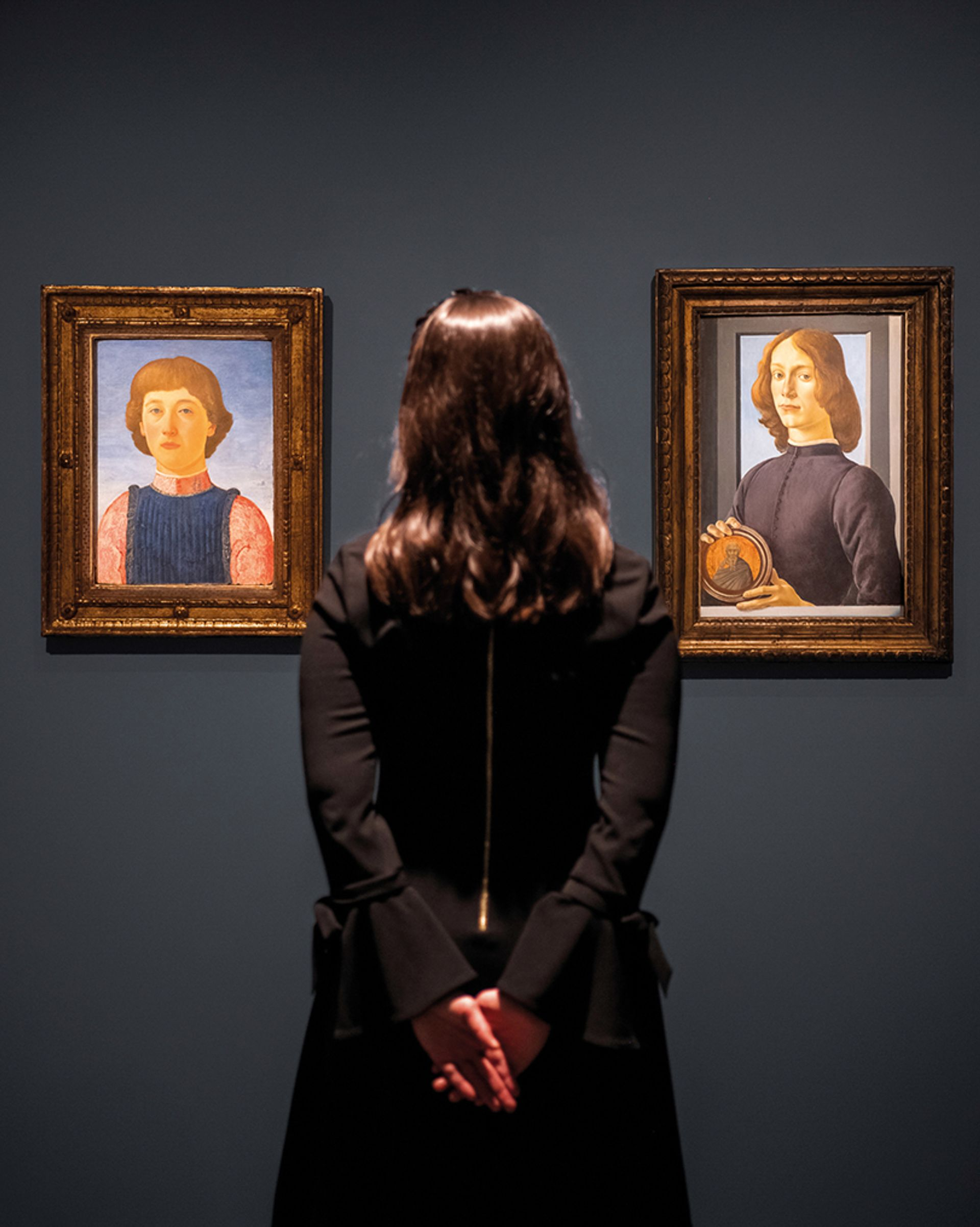 Sotheby's will auction Portrait of a Youth (left), attributed to Piero del Pollaiuolo, seen next to Botticelli's Young Man Holding a Roundel Photo: Julian Cassady Photography; Courtesy Sotheby's
