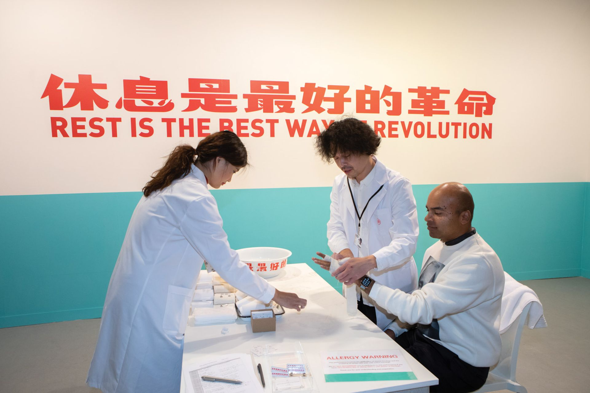The doctor will see you now: Tang Dixin offers a cure for world-weary fairgoers © David Owens