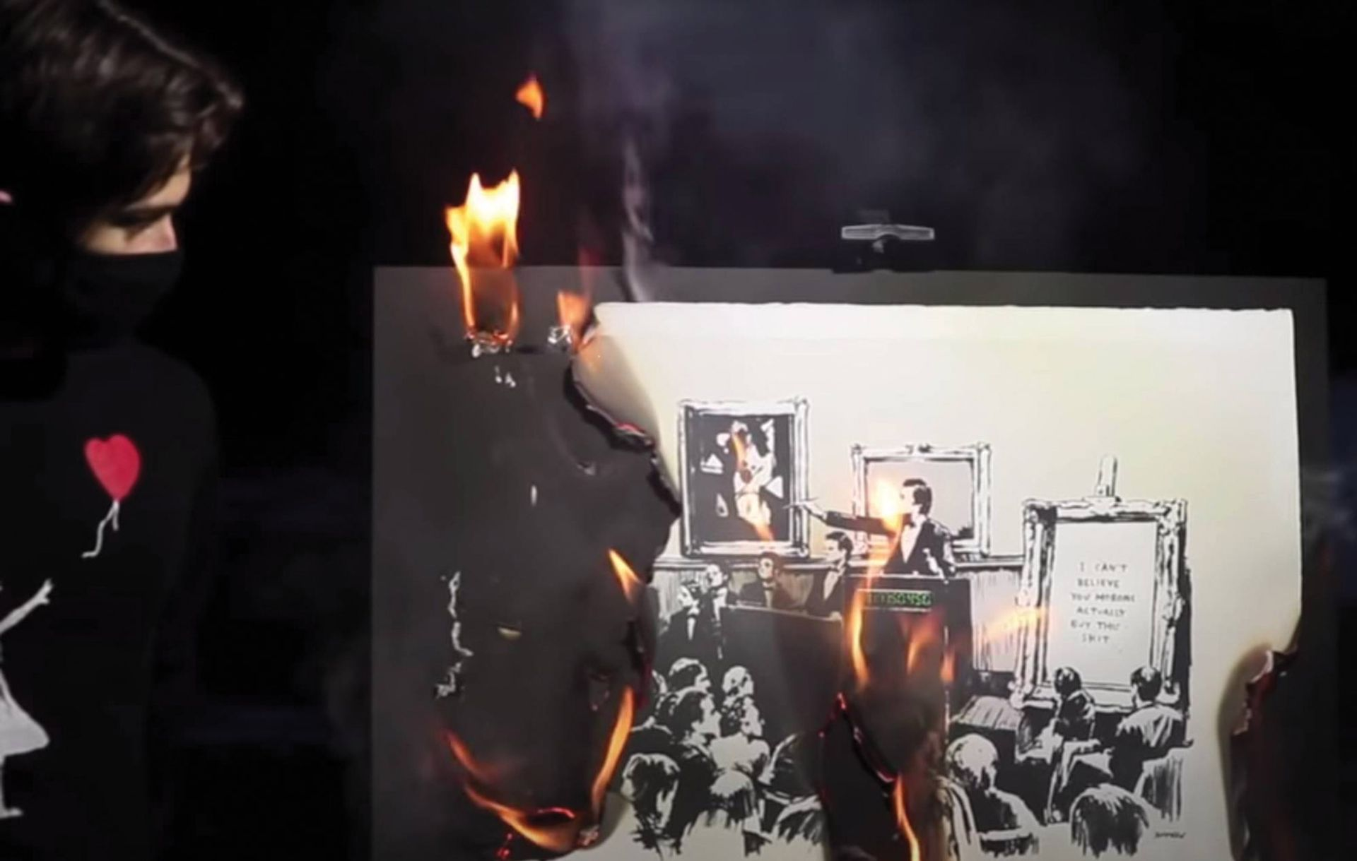The live-streamed burning ceremony of Banksy's Morons (2006) by the collective Burnt Banksy ©Banksy. Photo: Burnt Banksy