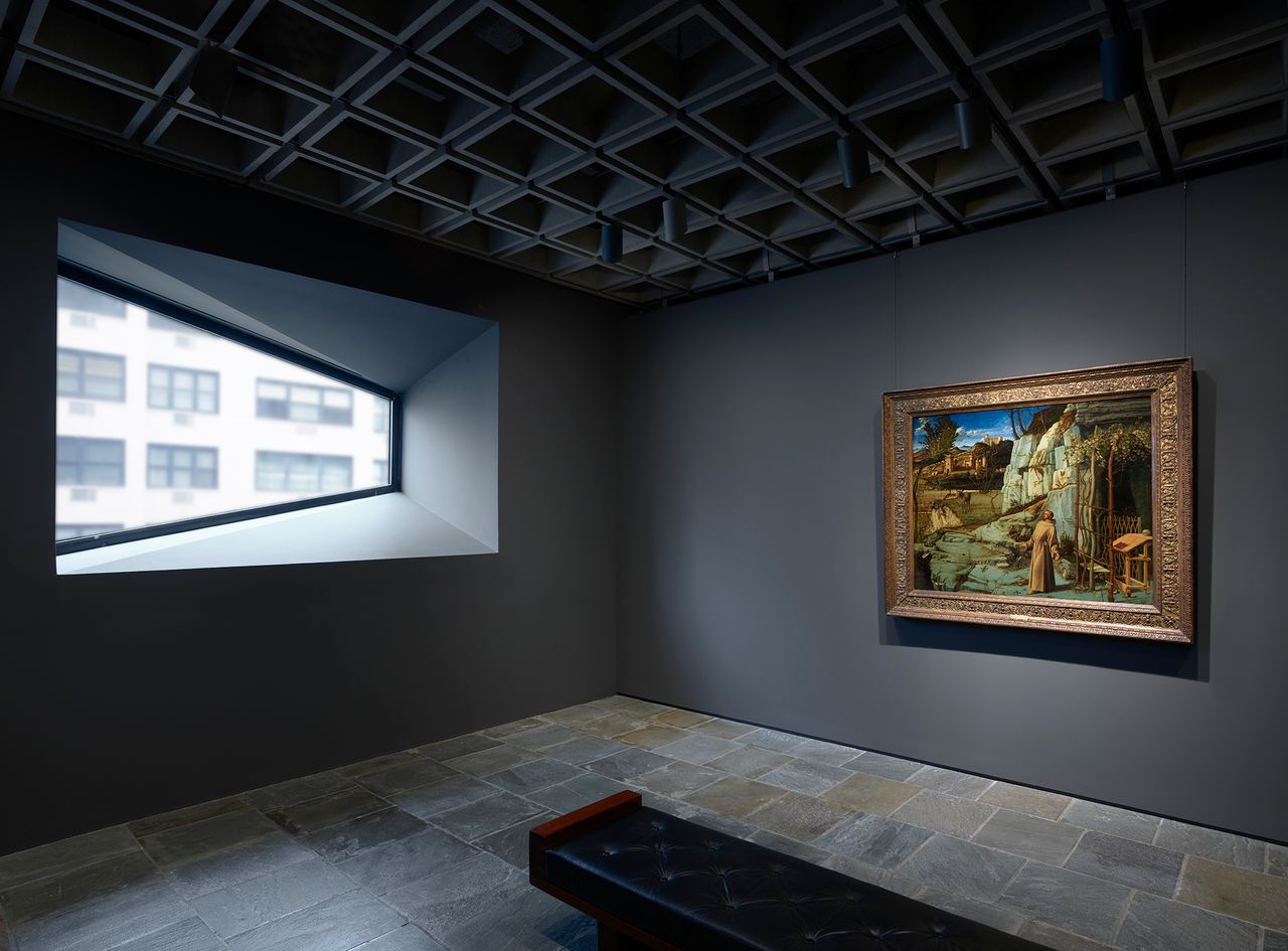 Bellini's St. Francis in the Desert, from around 1476–78, stands in start contrast to the Brutalist window of the Breuer building Courtesy of the Frick Collection; photo: Joe Coscia