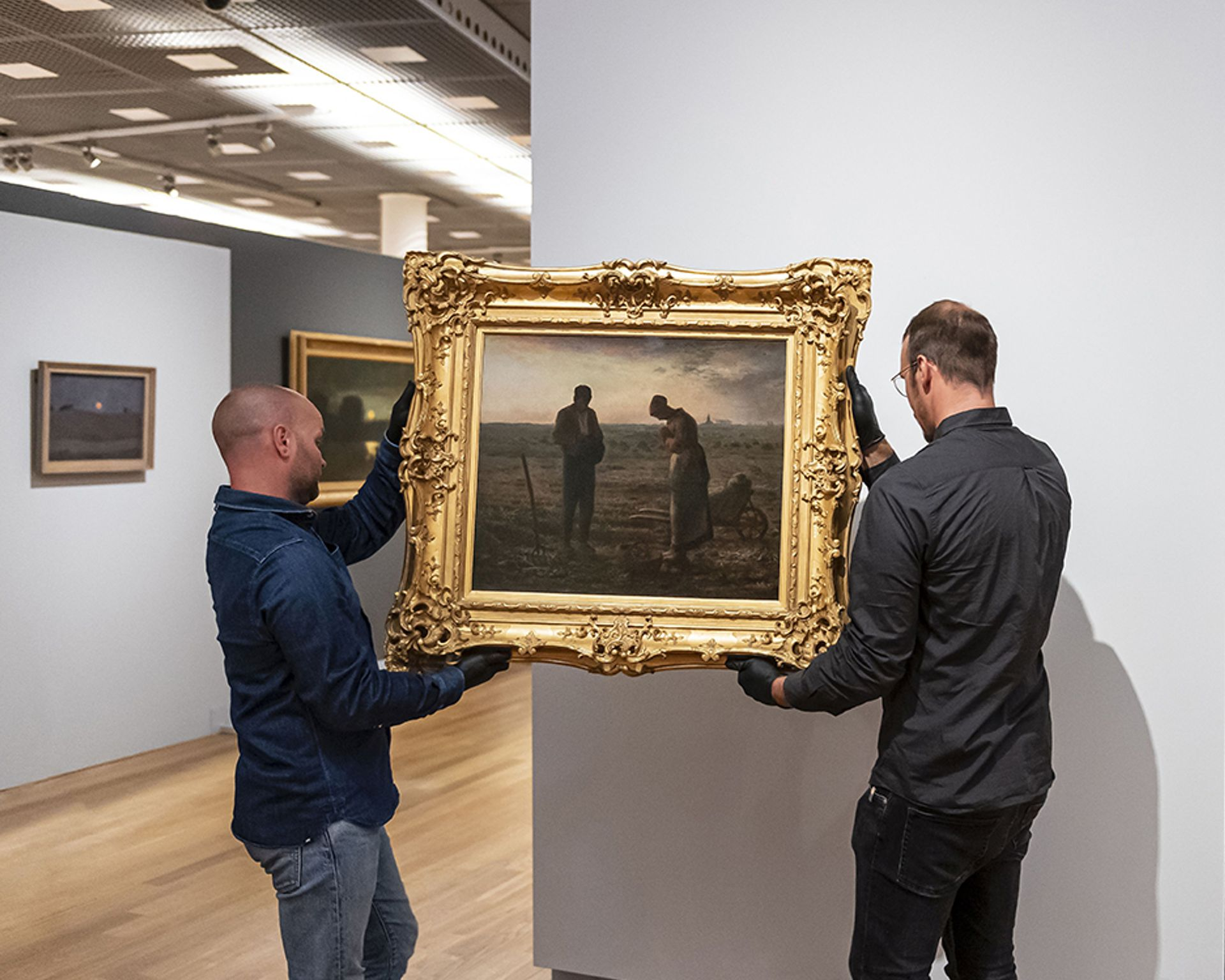 Jean-François Millet's The Angelus (1857-59) being hung at the Van Gogh Museum, Amsterdam, on loan from the Musée d'Orsay, Paris Photo: Jan-Kees Steenman/SeeItYourself