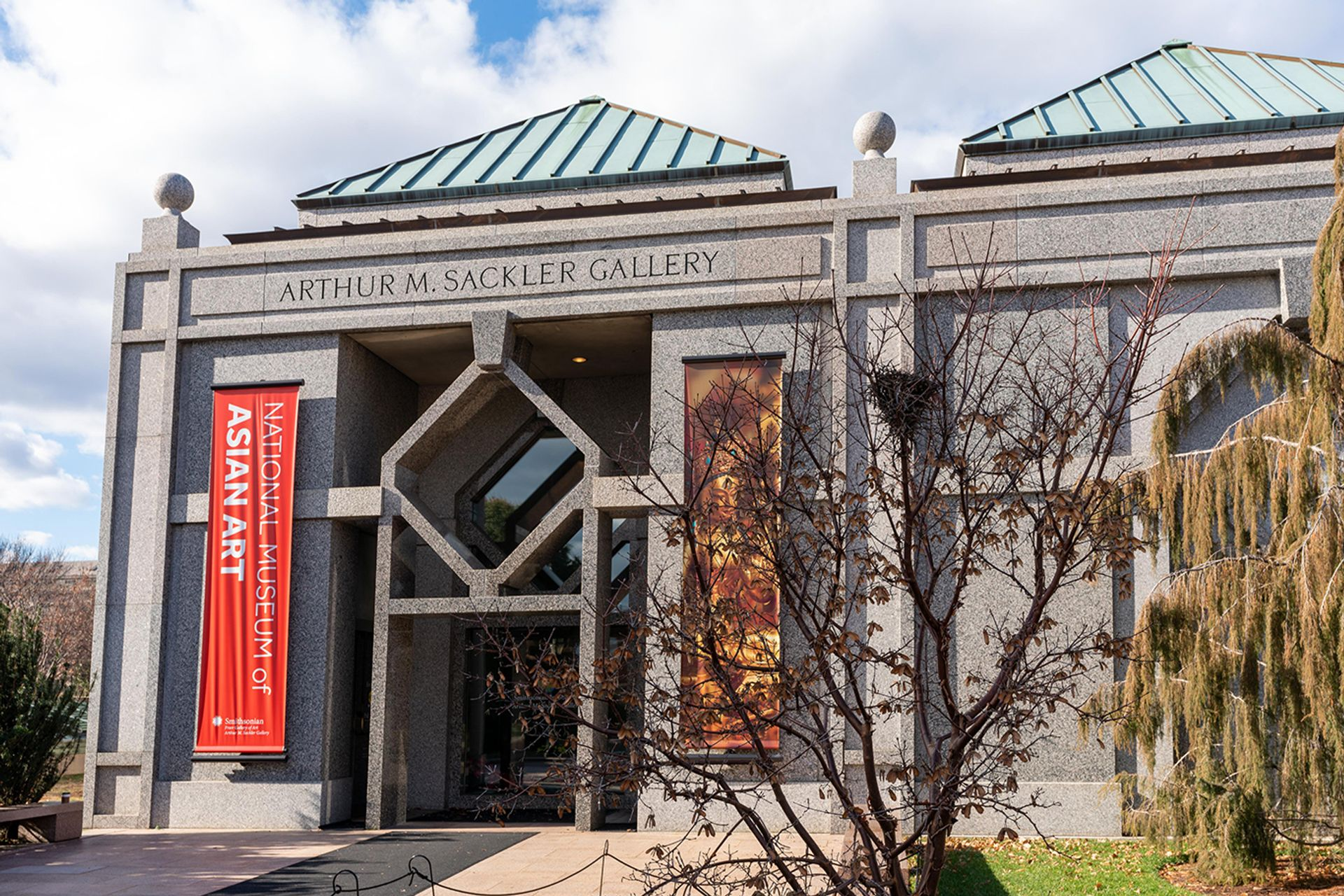 The Arthur M. Sackler Gallery with its new banner identifying it as part of a National Museum of Asian Art Freer and Sackler staff