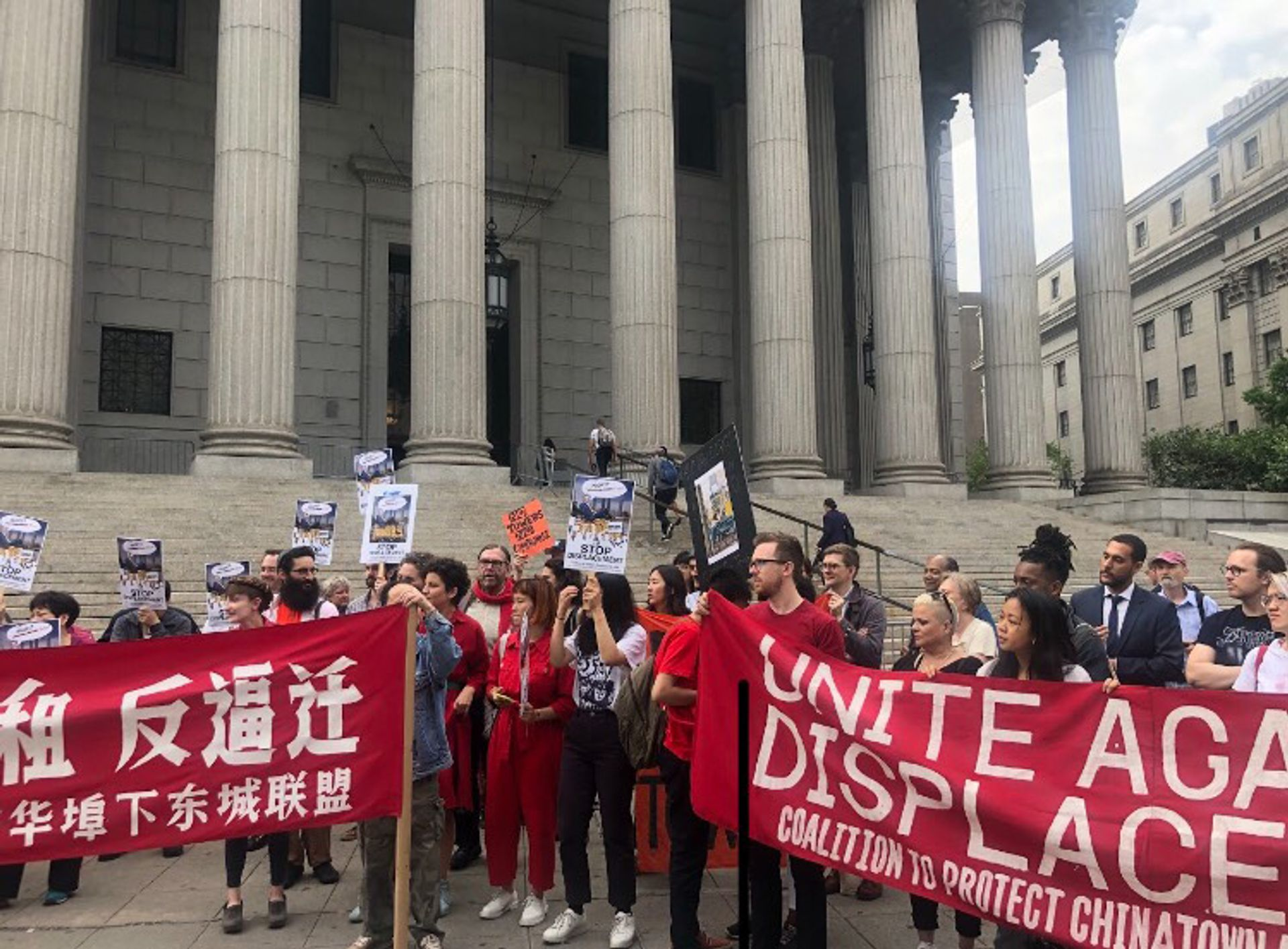 Local business owners and activists were joined by artists and gallery owners for a press conference on the steps of a Manhattan court house before the hearing Photo: Caitlin Kelmar