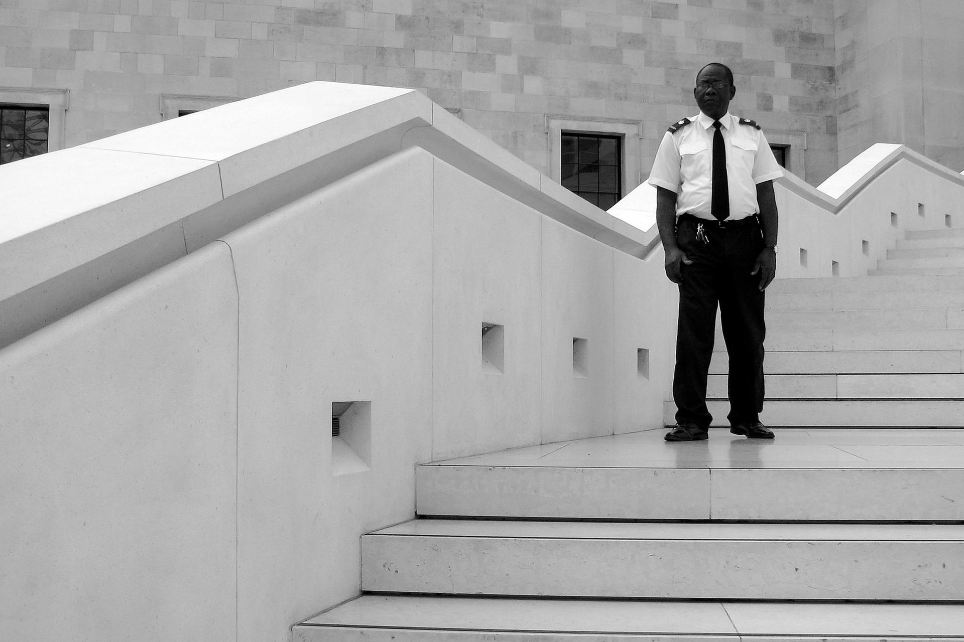 A security guard keeps watch over the British Museum in London Photo: CGP Grey