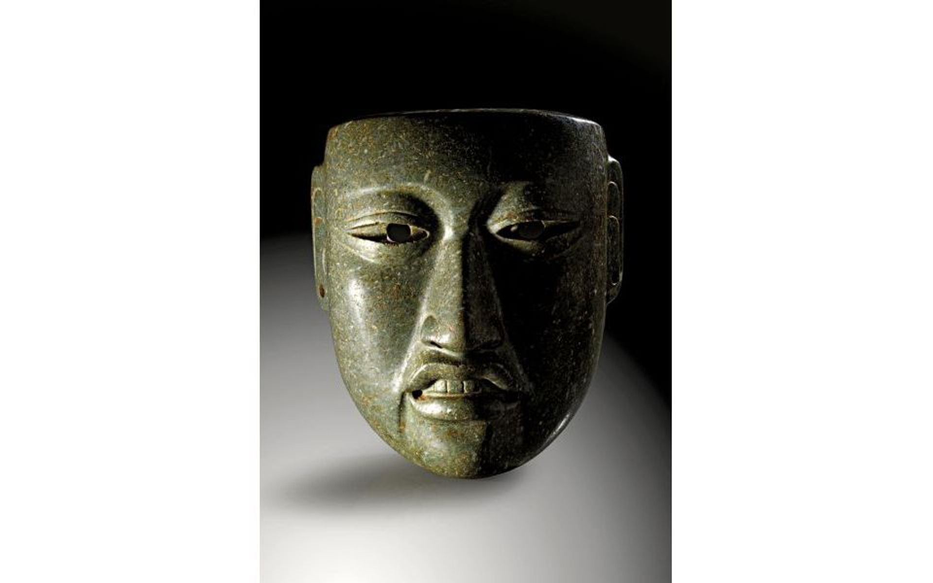 A green nephrite Olmec mask of a dignitary, around 1500-600 BC, offered for sale at Gerhard Hirsch Nachfolger, did not reach its reserve price