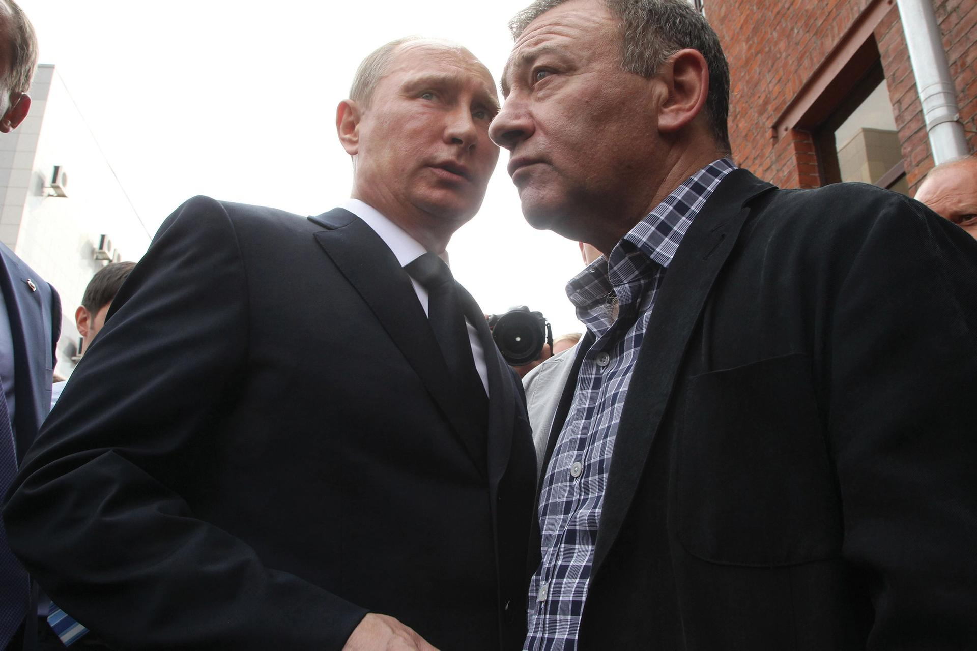 Arkady Rotenberg (right) and his brother Boris, who were named in the Senate report, are close allies of Vladmir Putin (left) Sasha Mordovets/Getty Images