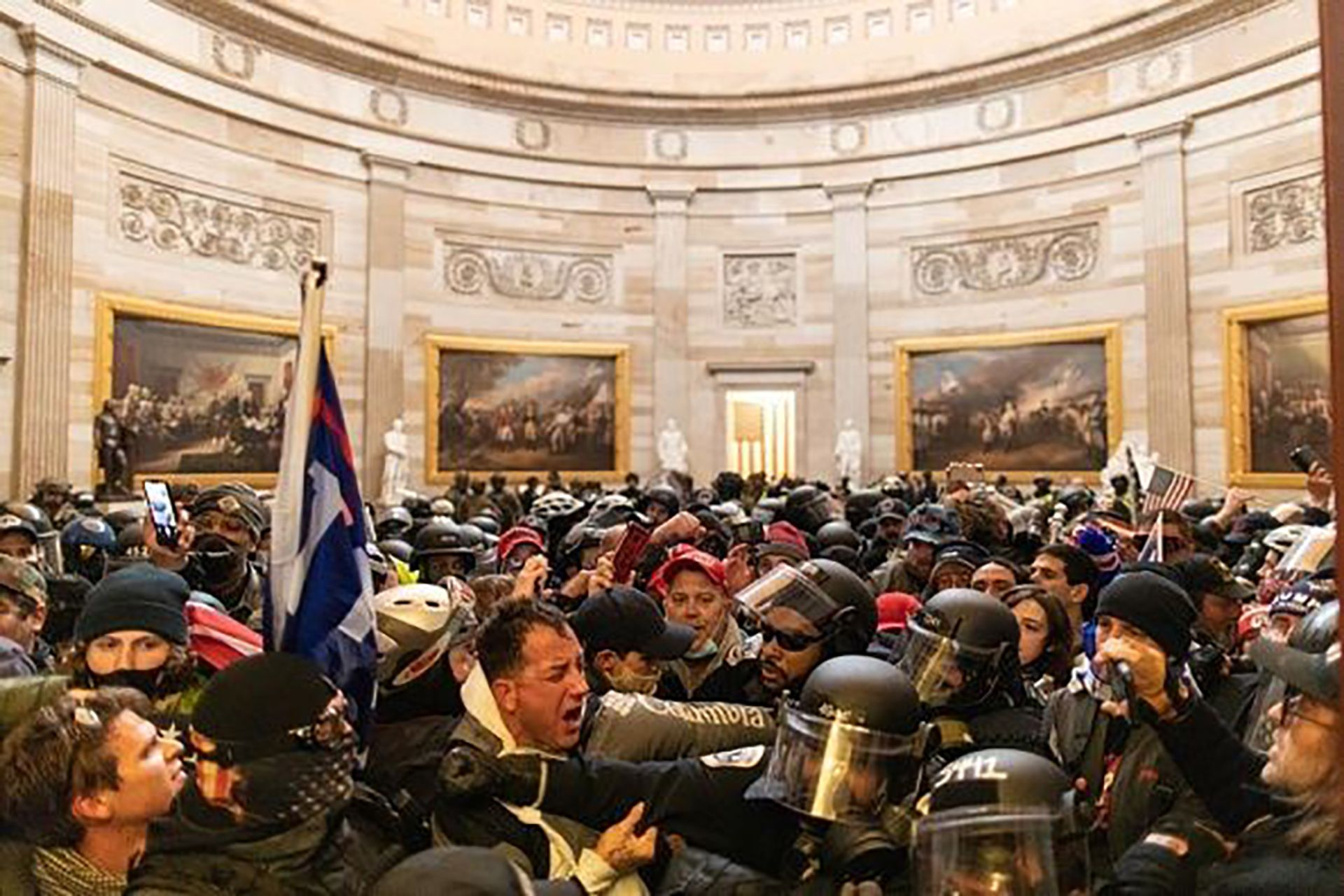 Pro-Trump protesters storming the public spaces of the US Capitol on 6 January Mostafa Bassim/Anadolu Agency via Getty Images