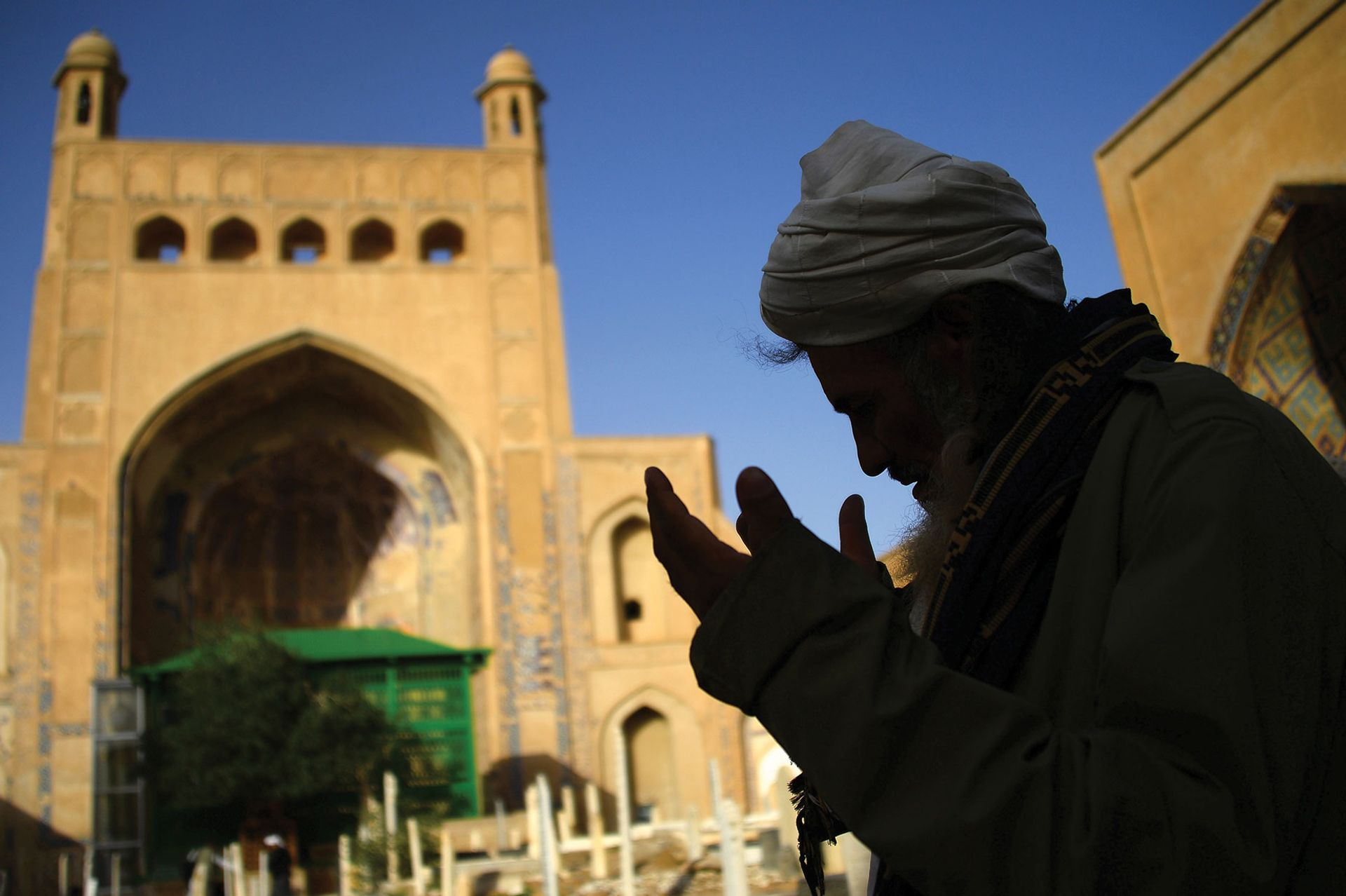 An Afghan man praying outside a mosque in Herat during Ramadan in 2018; there are fears that the devastating destruction of the country's cultural heritage 20 years ago could return Photo: Hoshang Hashimi/AFP via Getty Images
