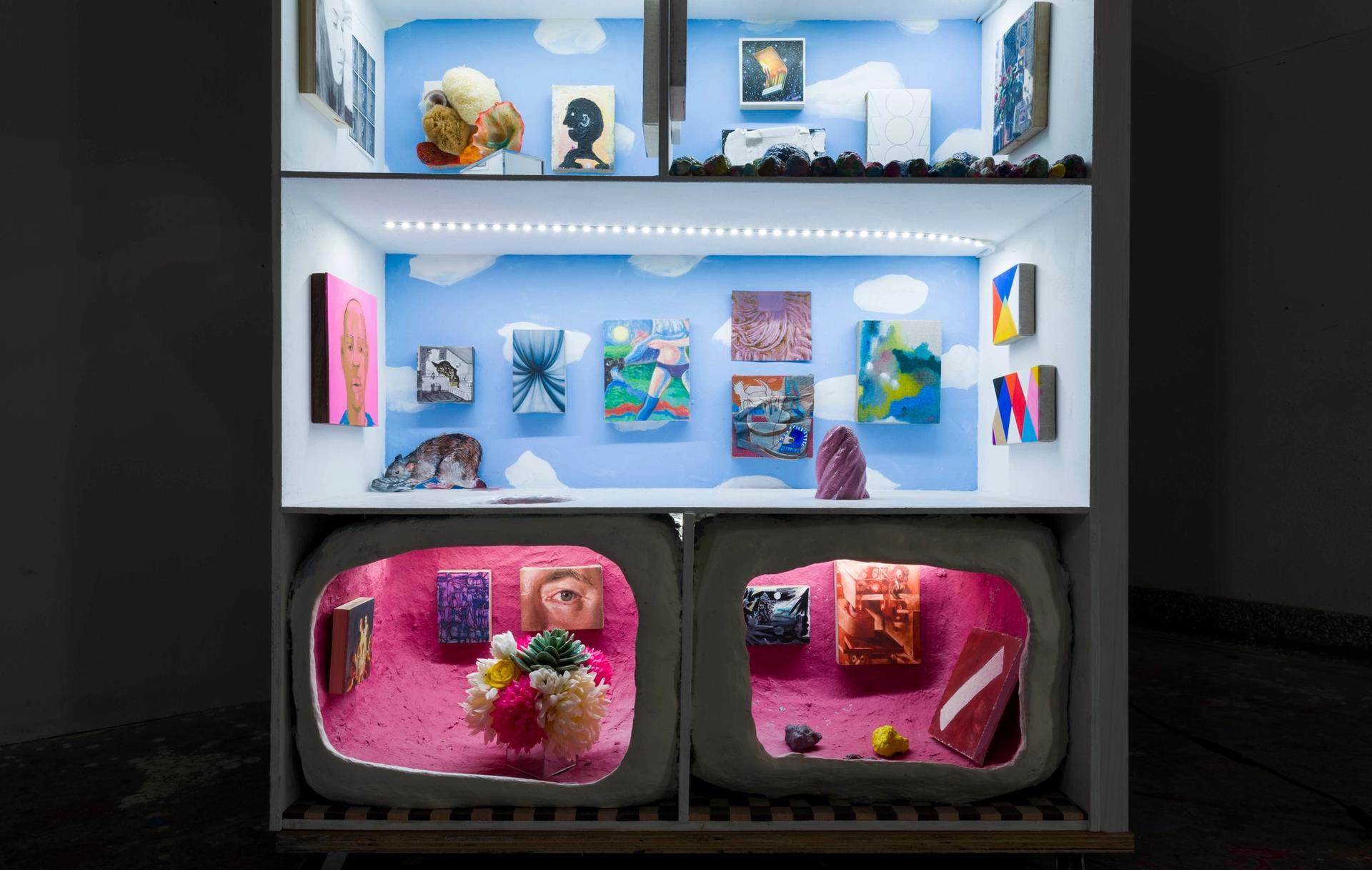 Miniature art hanging in the doll-sized galleries of Cat House Photo: Ruben Diaz