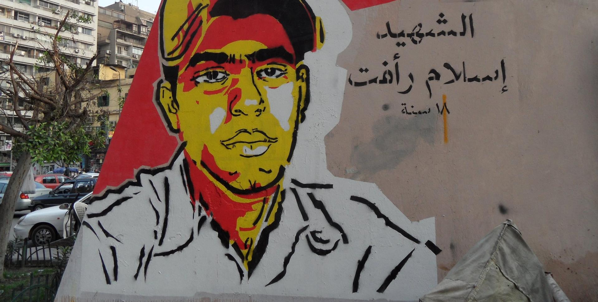 Ganzeer's memorial portrait for 18-year-old Islam Rafat Zinhoum who killed by a security truck on 28 January 2011. It was painted in March 2011 close to Tahrir Square. Photo: Alisdare Hickson Ganzeer's memorial portrait for 18-year-old Islam Rafat Zinhoum who killed by a security truck on 28 January 2011. It was painted in March 2011 close to Tahrir Square. Photo: Alisdare Hickson