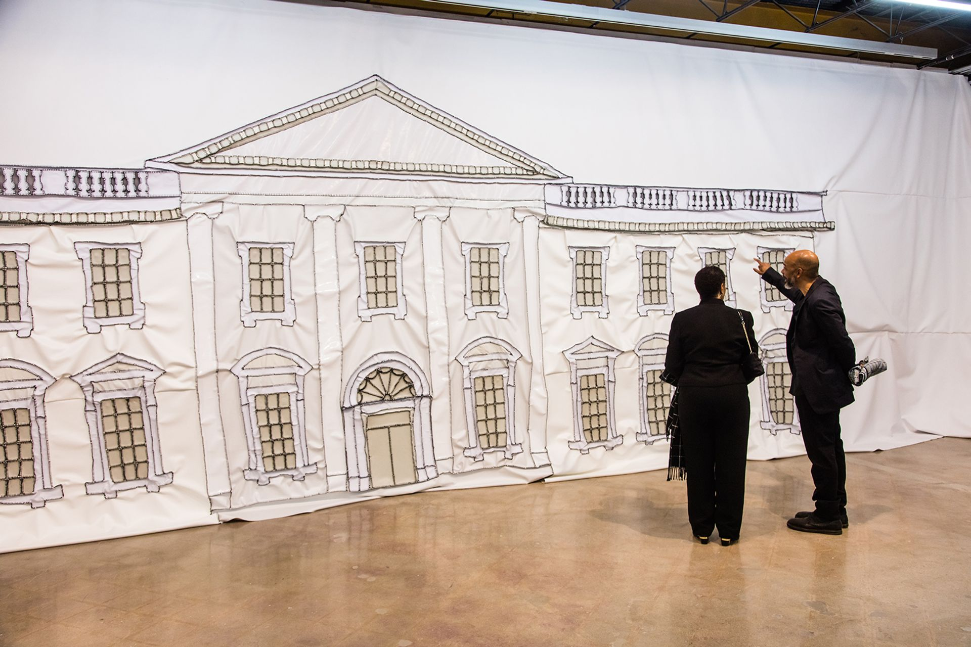 Rodney McMillian, right, with his mother Eunice Graham in front of White House Painting (2018) Photo: Brian Fitzsimmons