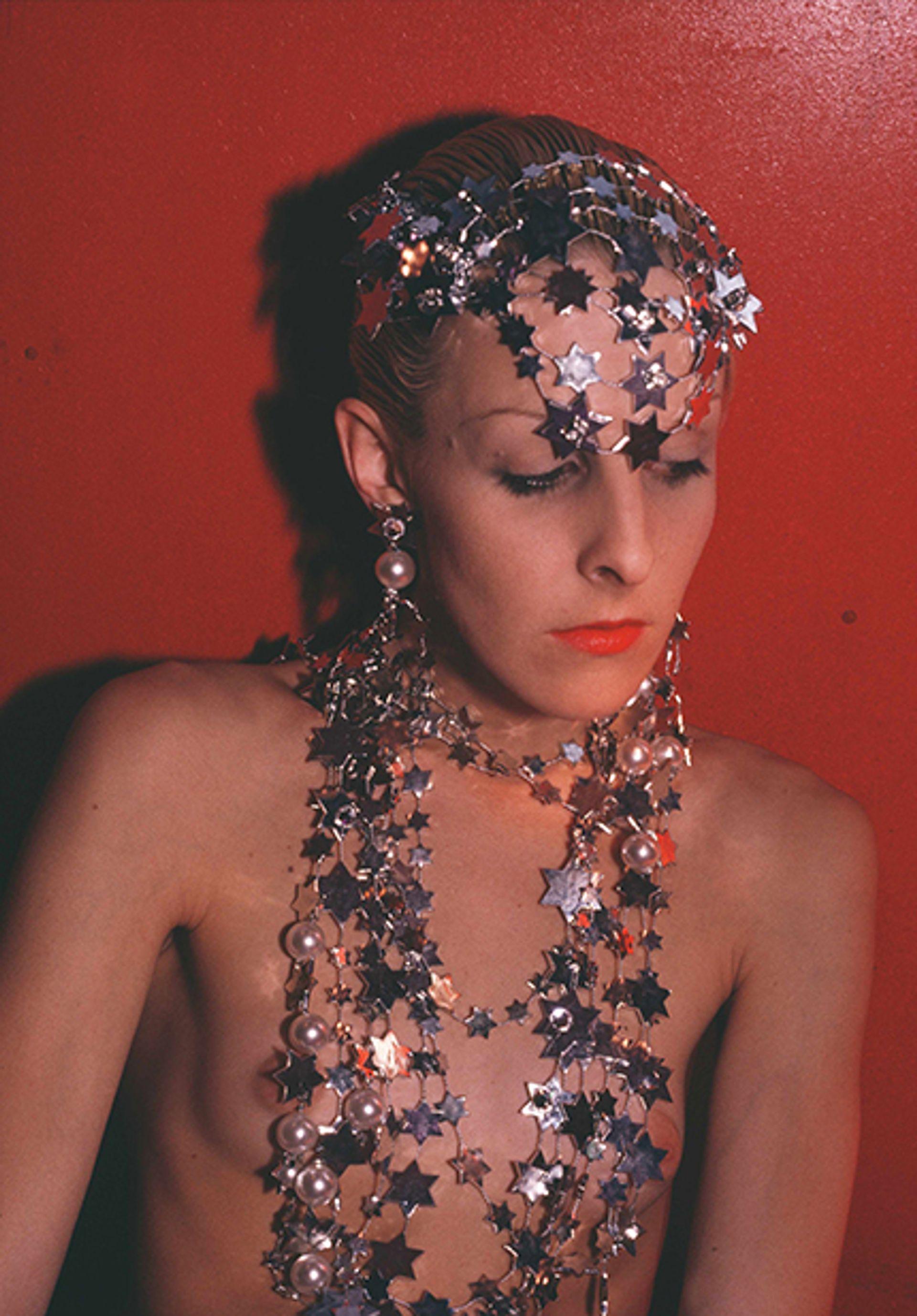 Greer Modeling Jewellery (1985) Nan Goldin