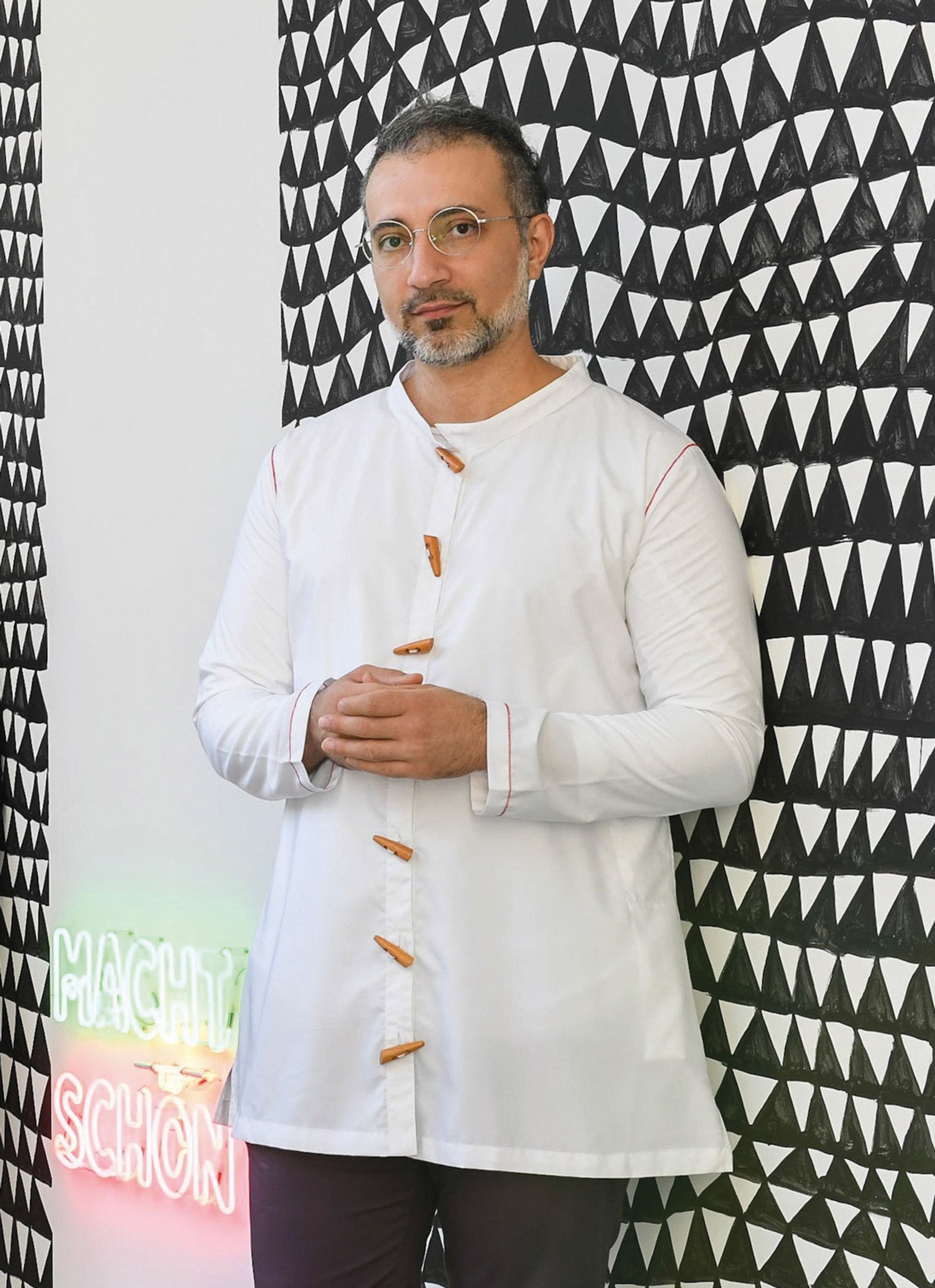 The artist Rokni Haerizadeh says the Tehran Museum of Contemporary Art  bought his painting after it was shown in Tehran in 2003. © Miquel Coll