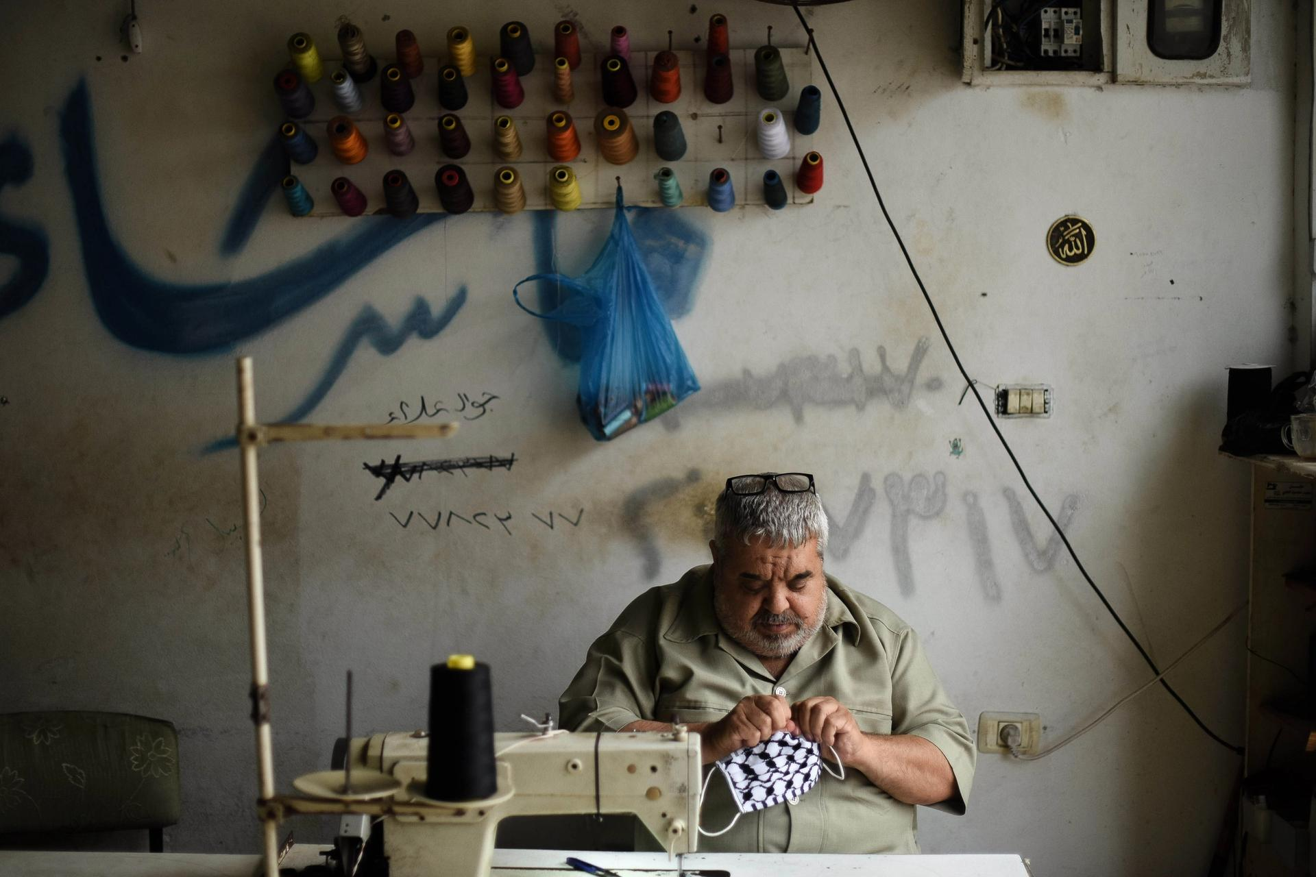 The face masks are being crafted and distributed from a workshop in Gaza