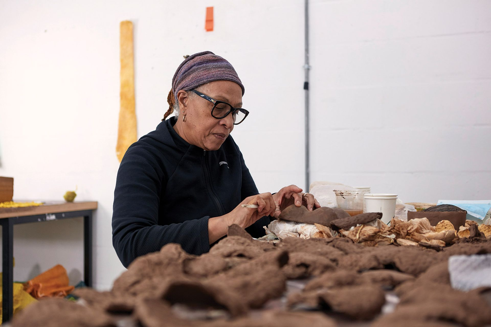 Ryan, at work at Spike Island, uses myriad materials, from bronze and clay to fruit skins and tea bags © Max McClure