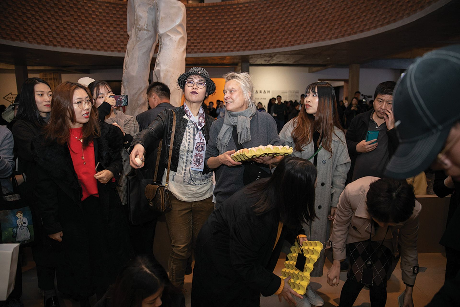 Sarah Lucas encourages participation in One Thousand Eggs, at the Red Brick Museum © Sarah Lucas; courtesy Red Brick Art Museum; Beijing; and Sadie Coles HQ; London