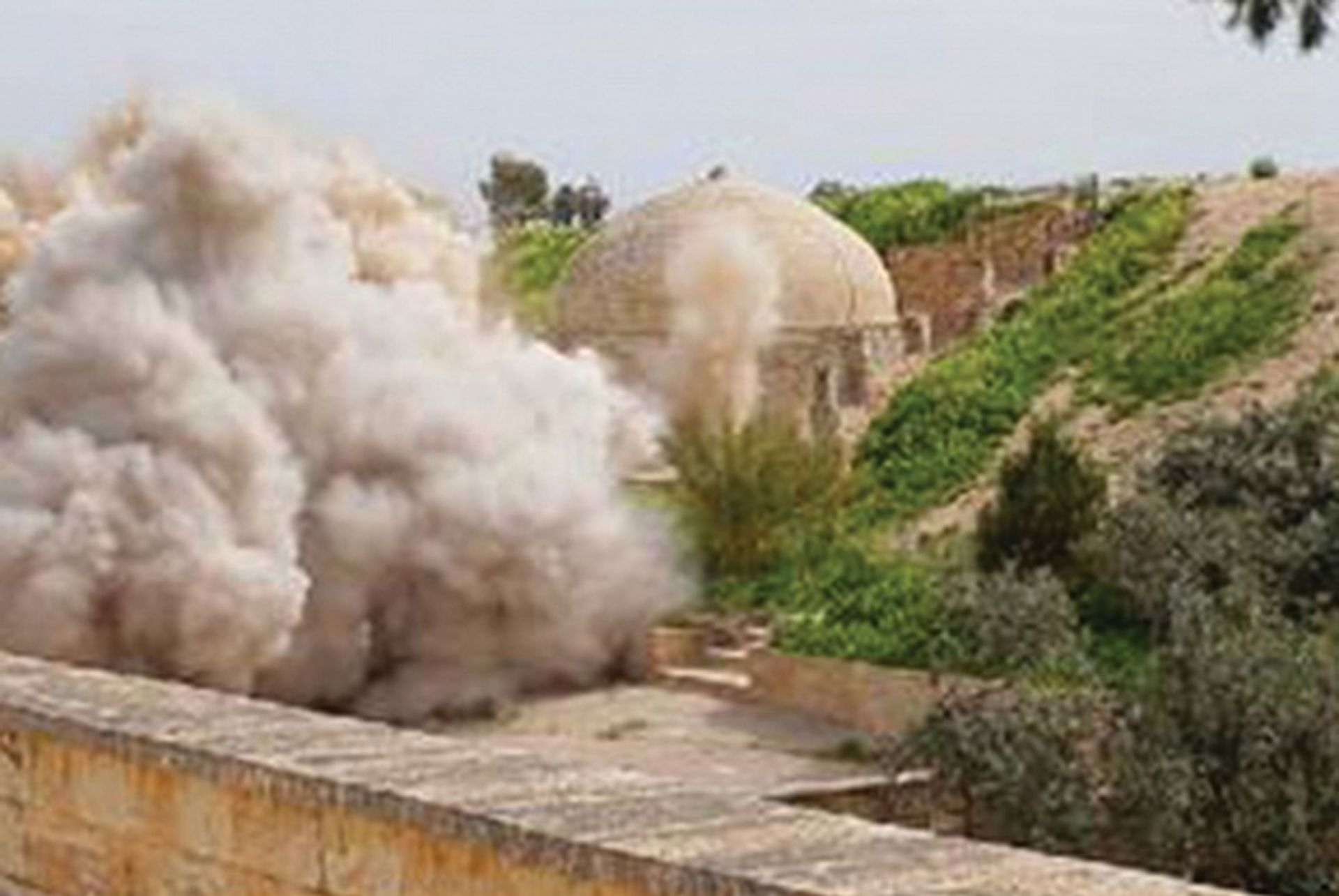 An Islamic State image of explosions at the fourth-century Christian Mar Behnam monastery in Iraq