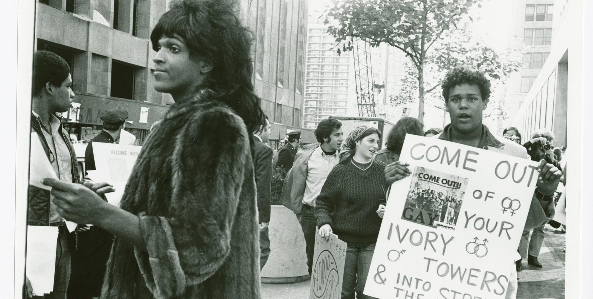Untitled, around 1970. (Marsha P. Johnson hands out flyers in support of gay students at NYU) © Diana Davies / New York Public Library / Art Resource, NY