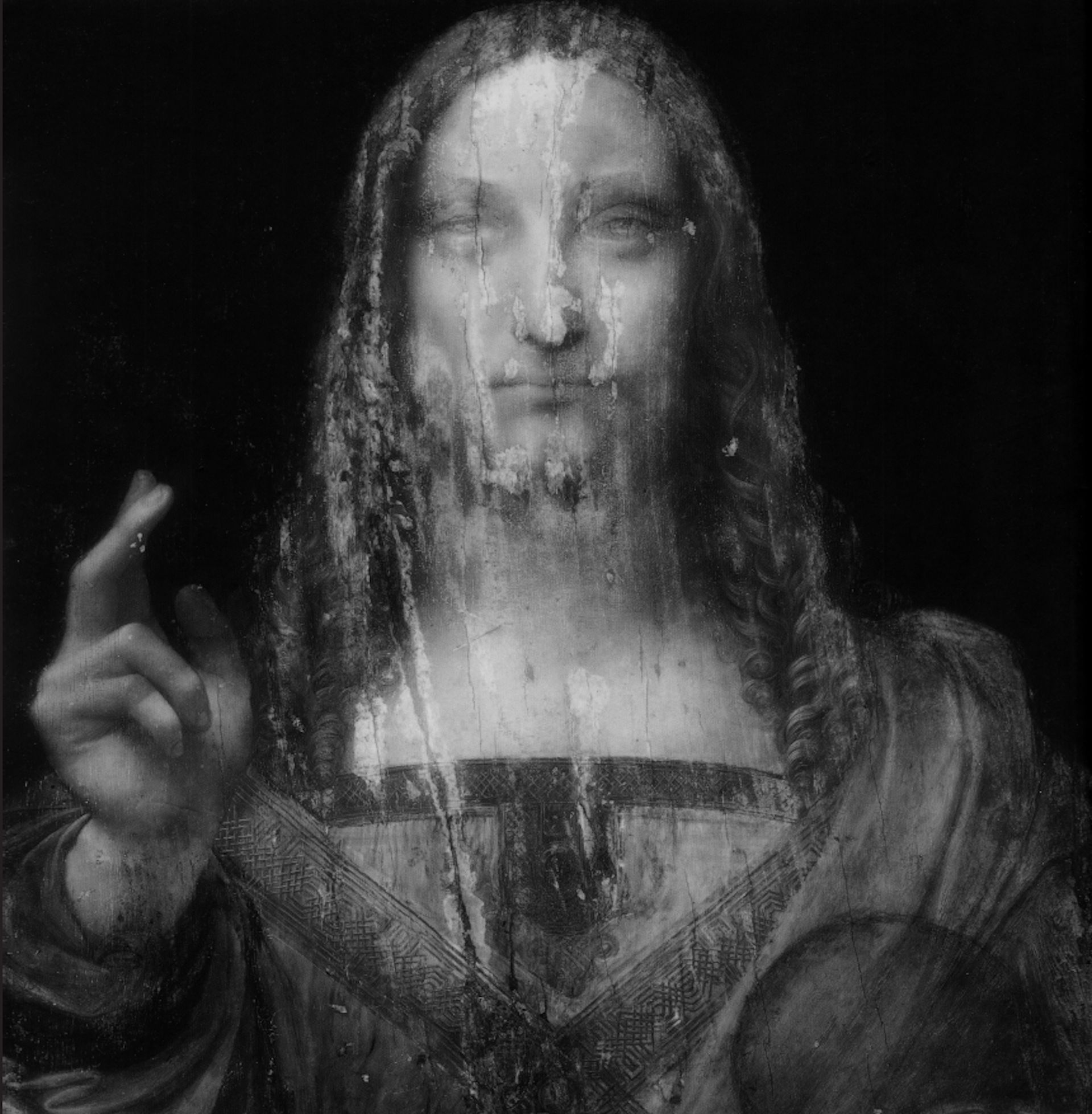 The back page of the book is the full-bleed of the infra-red reflectography of the Salvator Mundi