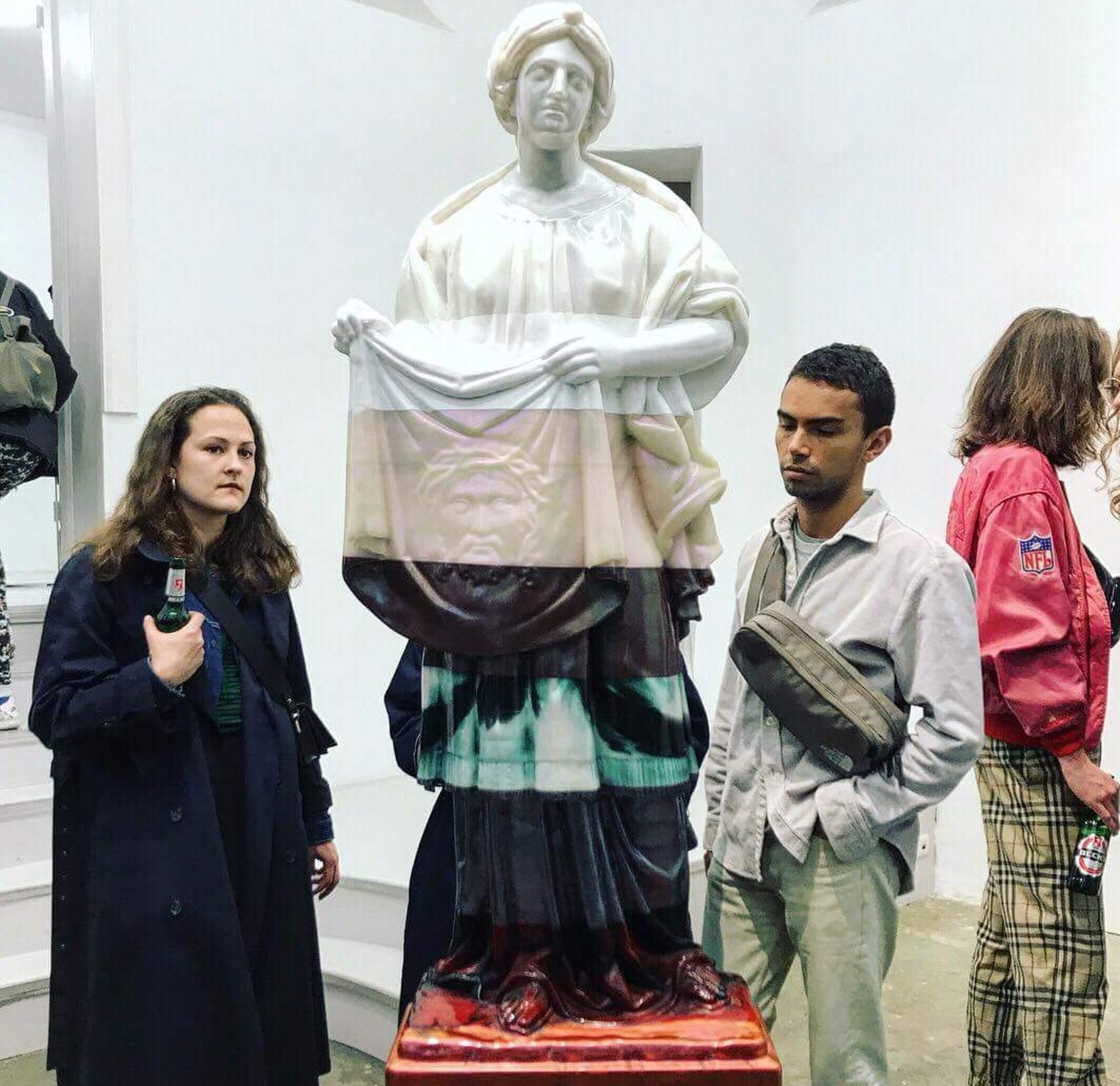 Visitors to Oliver Laric's exhibition at Tanya Leighton during Gallery Weekend Berlin Laurie Rojas