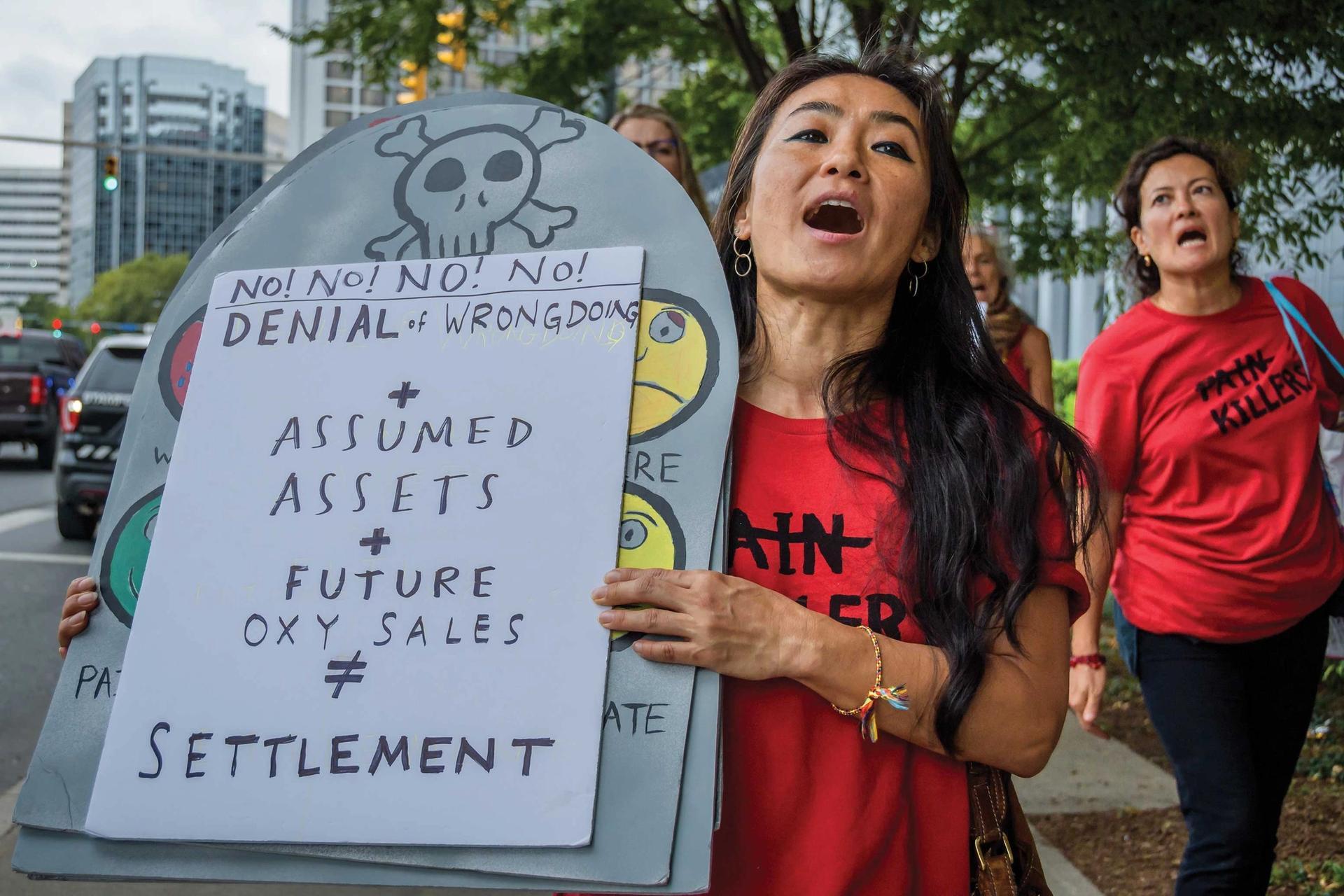 Protesters demonstrate outside of Purdue Pharma's headquarters Photo: Erik McGregor/LightRocket via Getty Images