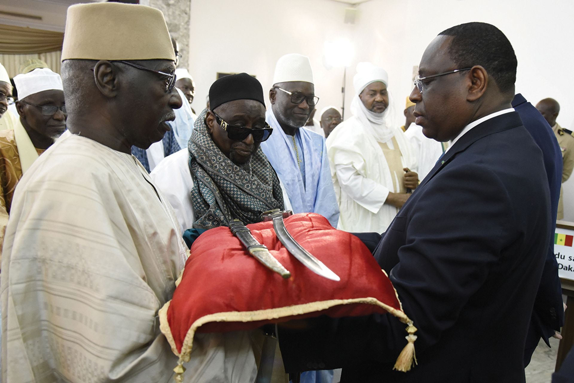 Senegal President Macky Sall, right, receives the sword El Hadj Omar Saidou Tall during a ceremony at the Palace of the Republic in Dakar, Senegal, on November 17, 2019 Photo: by Seyllour /AFP via Getty Images