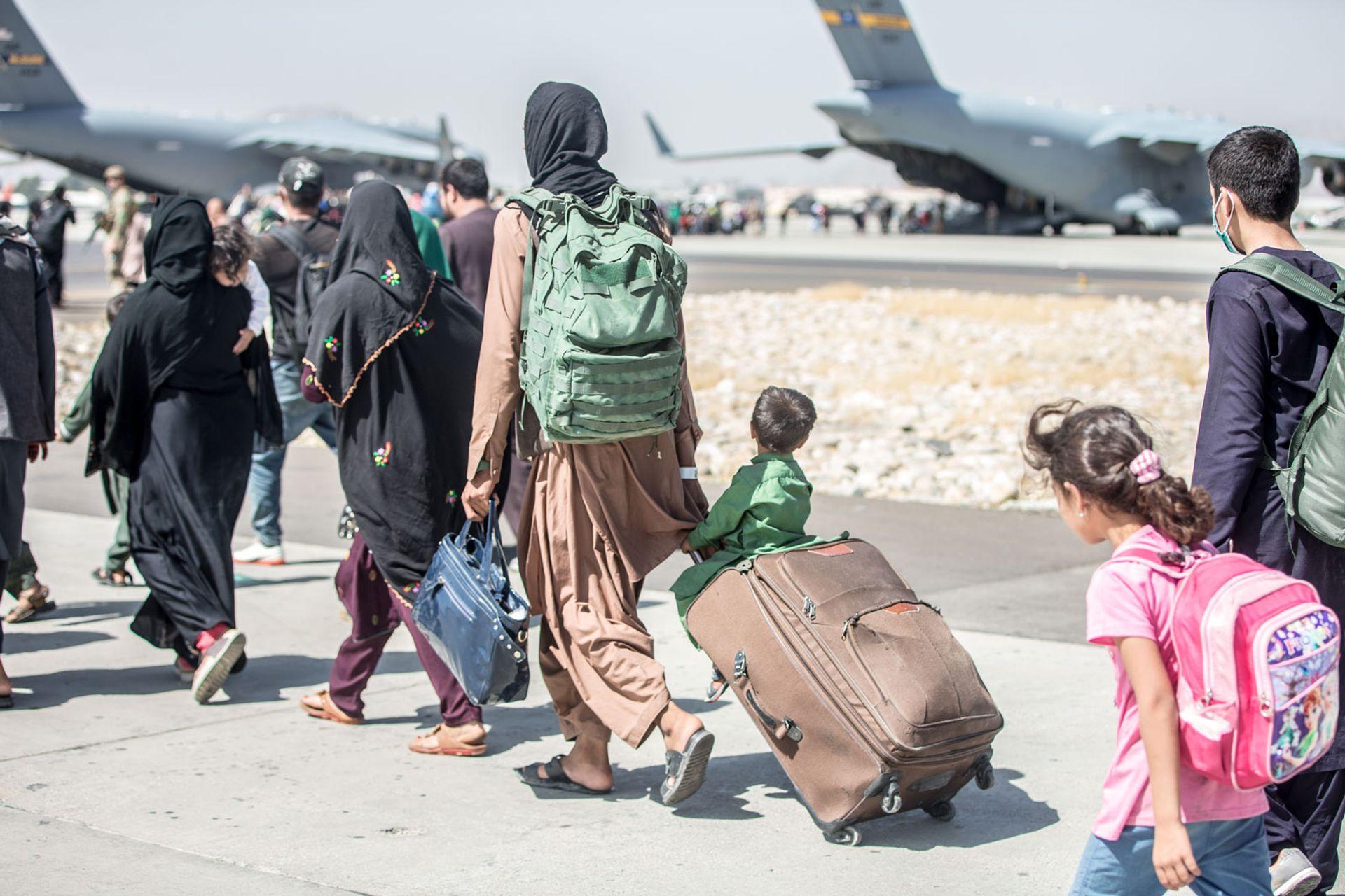 People being evacuated at Hamid Karzai International Airport in Kabul earlier this week Photo: cc U.S. Marine Corps; Sgt. Samuel Ruiz
