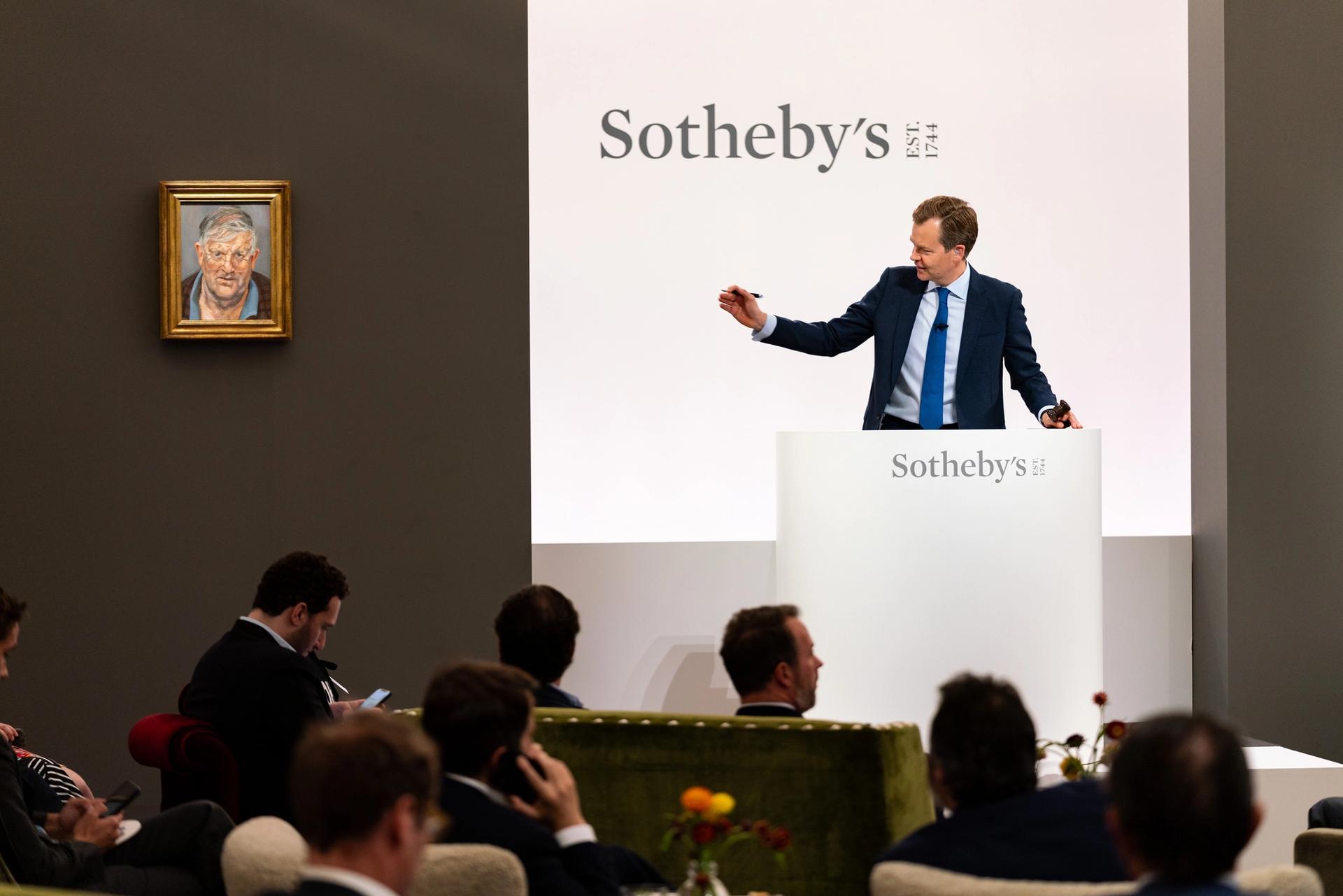 Oliver Barker at the rostrum of Sotheby's British Art evening sale Courtesy of Sotheby's
