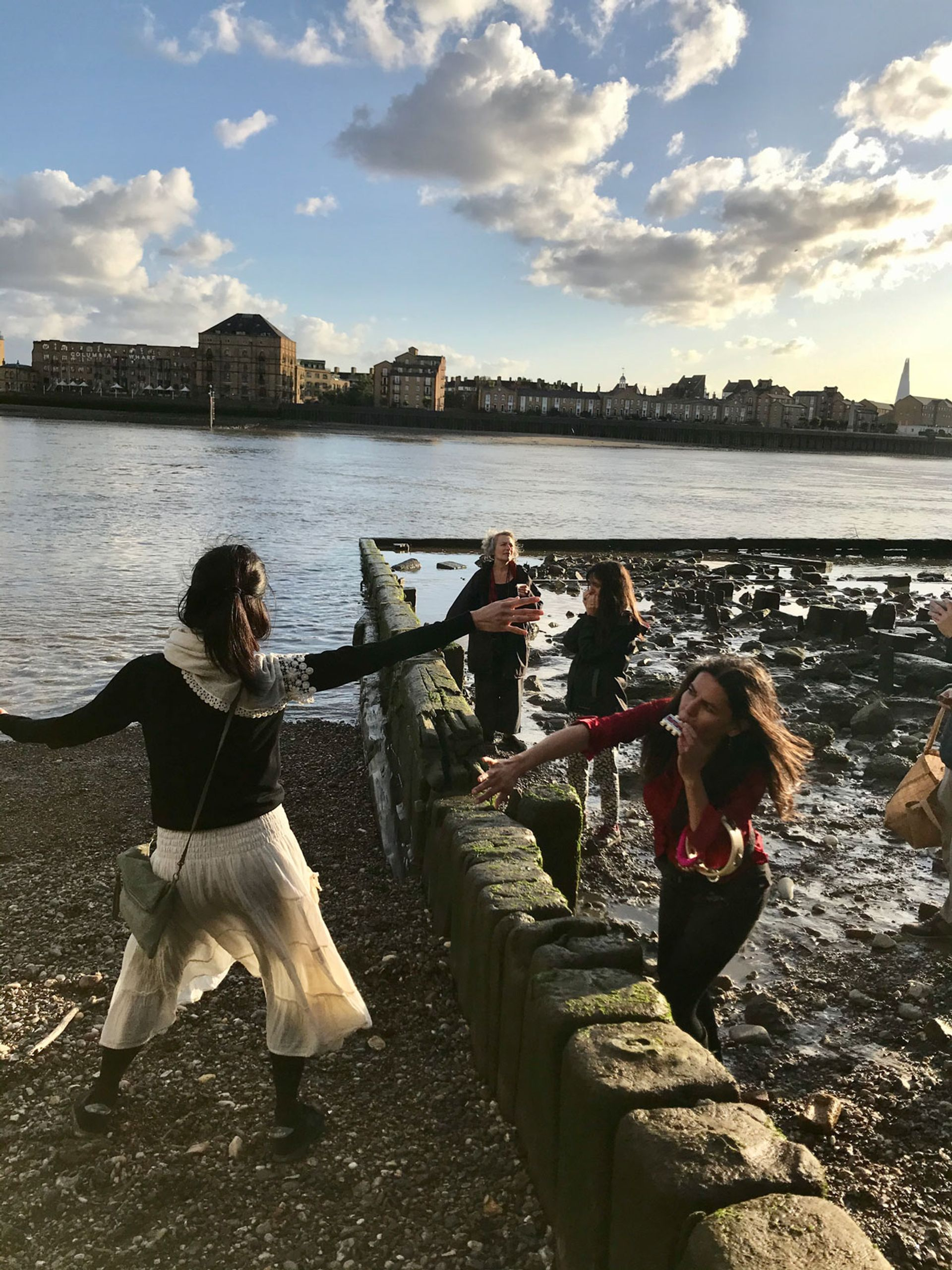 Luna Montenegro and friends  performing music and incantations by the River Thames Photo: Louisa Buck