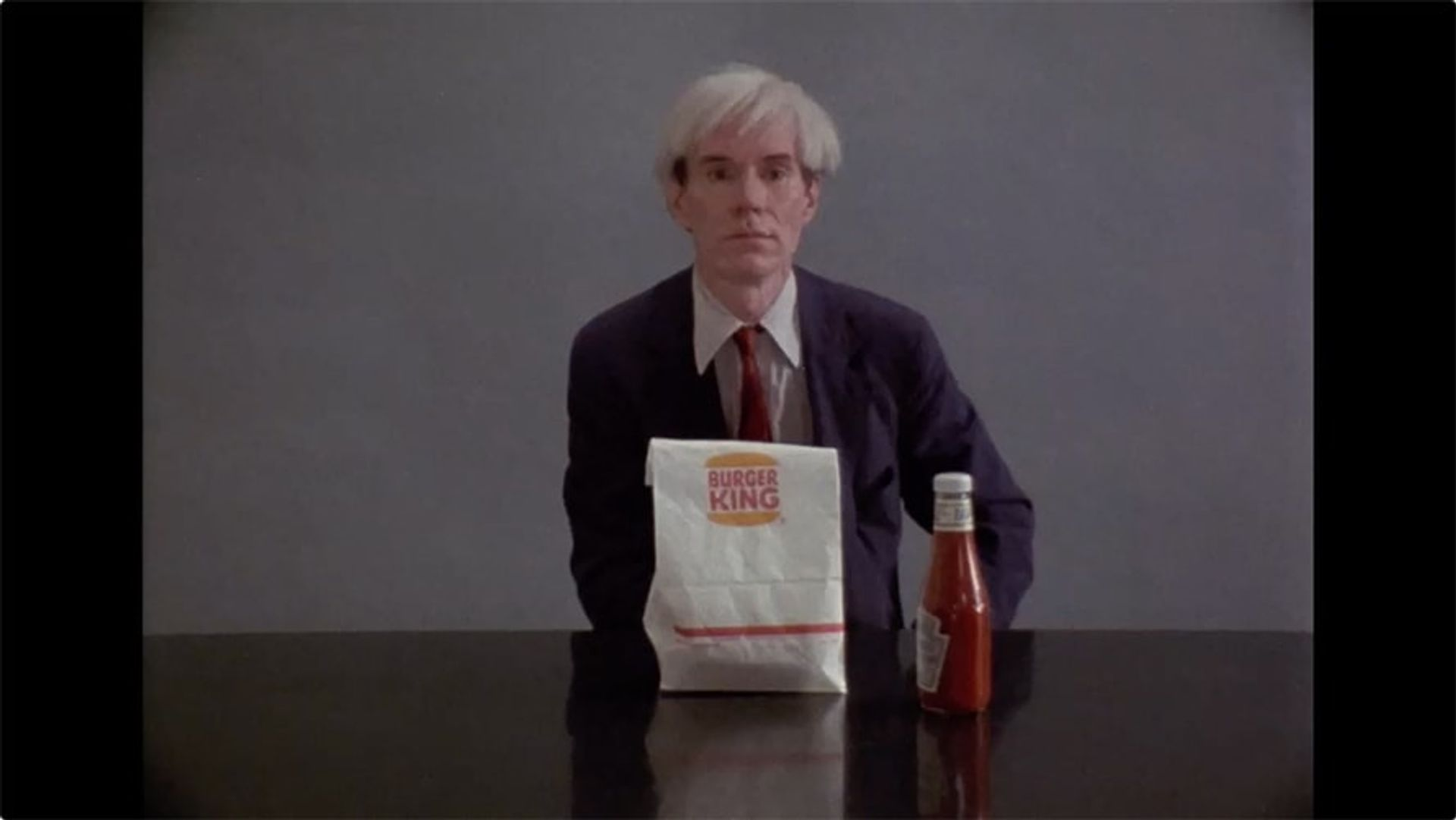 Andy Warhol eats a hamburger, from the Danish director Jorgen Leth's 1982 film 66 Scenes from America