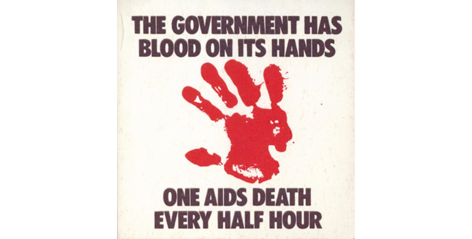 A poster by the ACT UP Collective Gran Fury reads: The government has blood on its hands