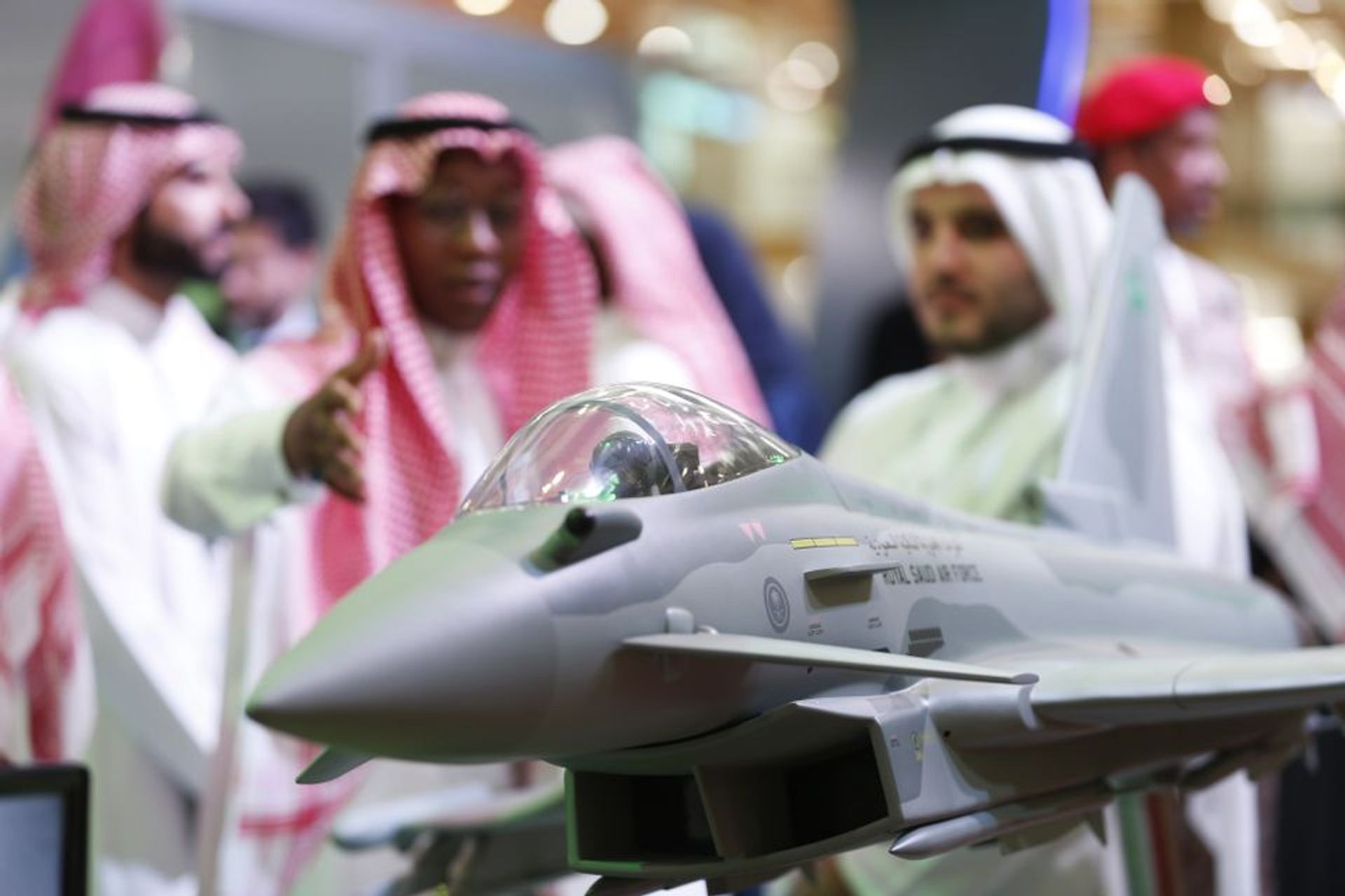 Visitors look at a display model of a Saudi Air Force Eurofighter Typhoon jet, manufactured by BAE Systems Plc, at the Armed Forces Exhibition for Diversity of Requirements and Capabilities (AFED) in Riyadh, Saudi Arabia, on 27 February Mohammed Almuaalemi/Bloomberg via Getty Images