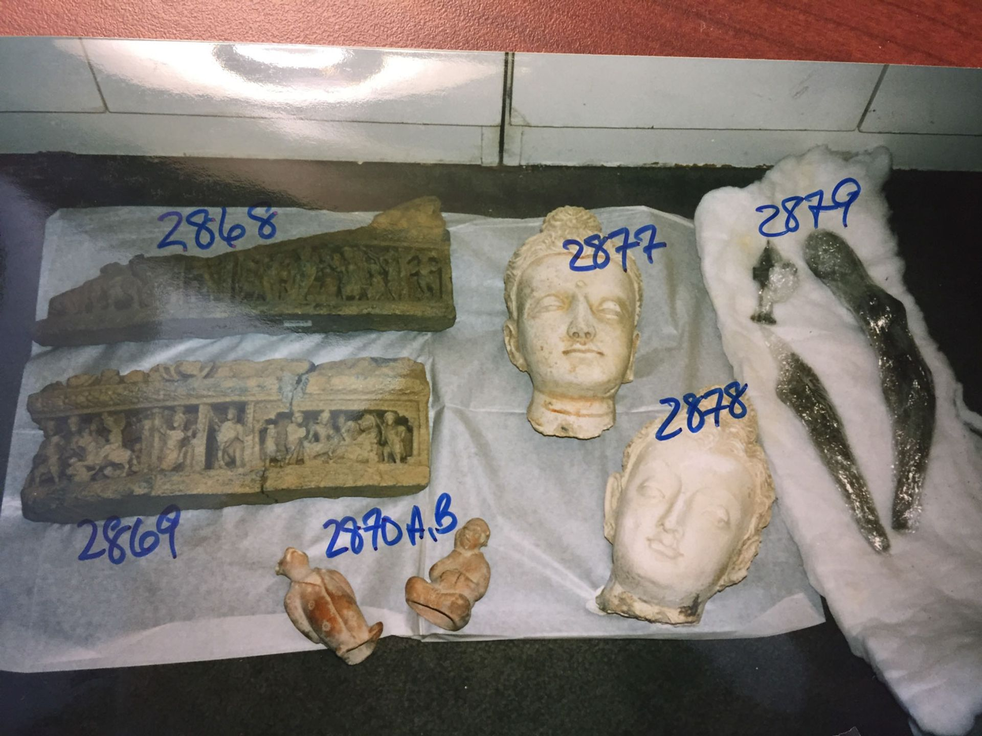Among the objects seized by US authorities from storage facilities in New York were two stucco Gandharan Buddha heads that were excavated from Afghanistan after paying off a Mujahedeen commander who controlled the area