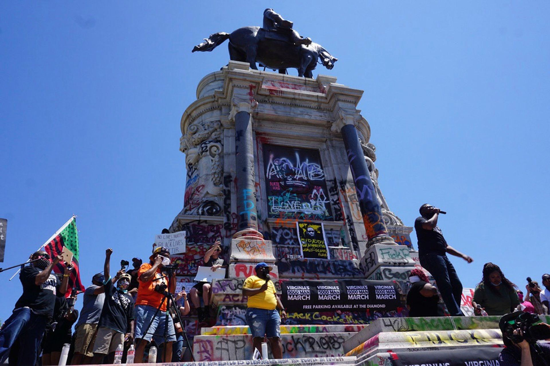 Protesters in Richmond, Virginia demonstrating against racial injustice and police brutality next to a statue of the Confederate general Robert E. Lee Artur Gabdrahmanov/Sputnik via Associated Press