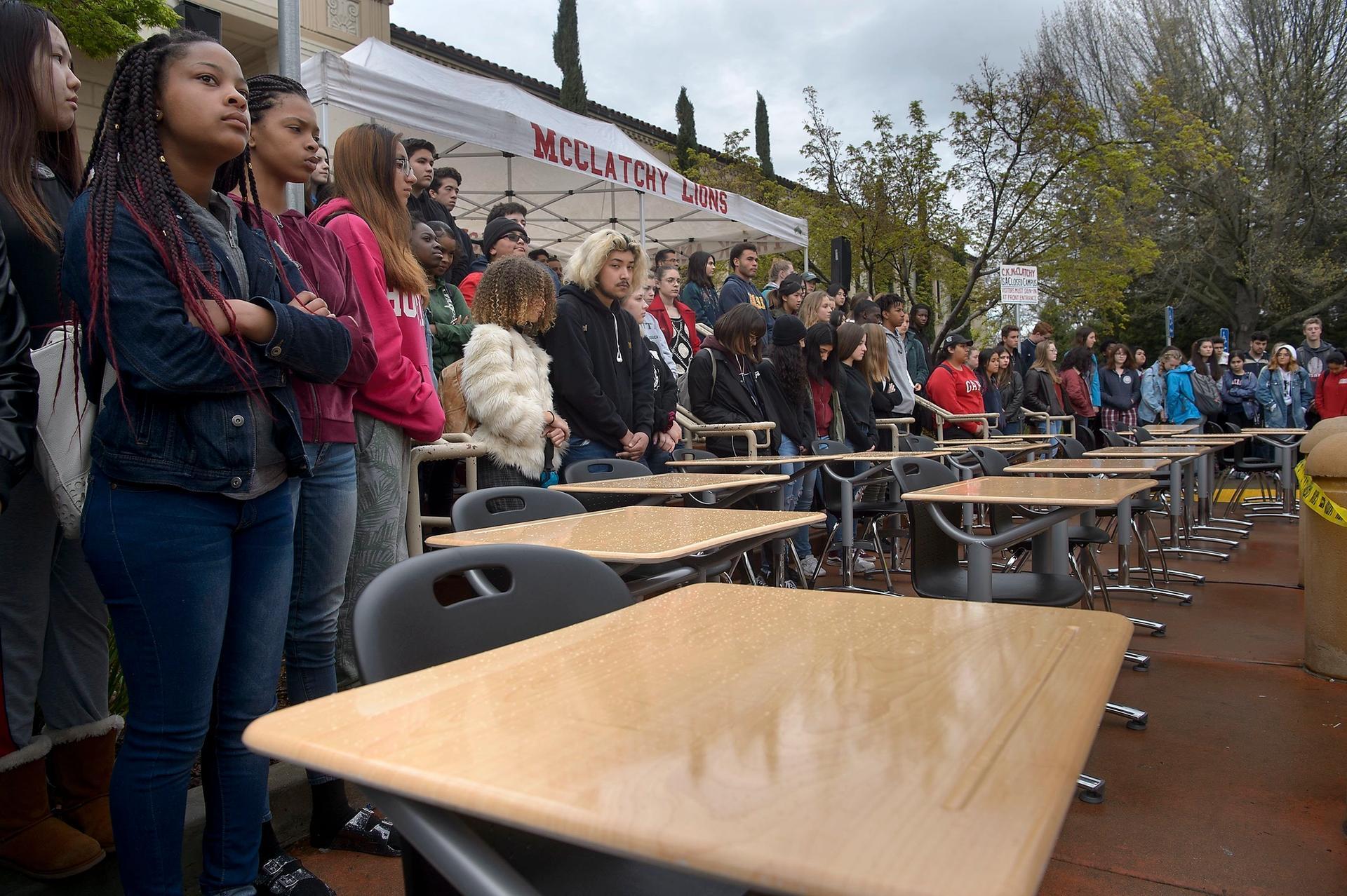 Students at McClatchy High School in Sacramento, California gather around 17 empty desks representing the shooting victims from Marjory Stoneman Douglas High School in Parkland, Florida Randall Benton/The Sacramento Bee via AP