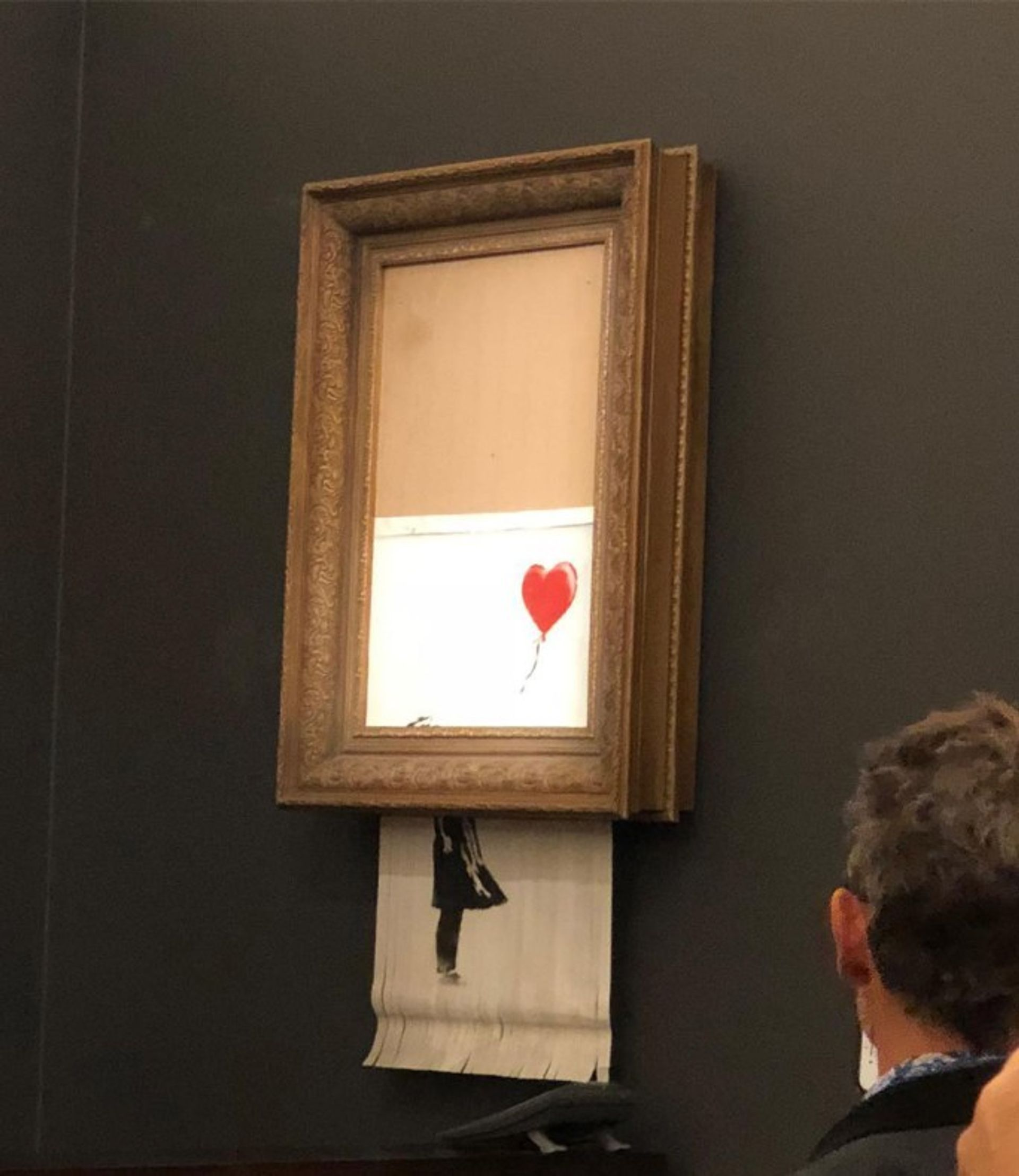 Banksy's Girl With Balloon (2006) mysteriously self-destructed at the end of a Sotheby's auction Casterline Goodman Gallery