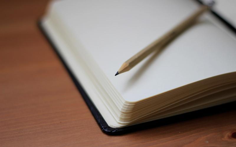 Schlafprobleme Stift und Notizbuch