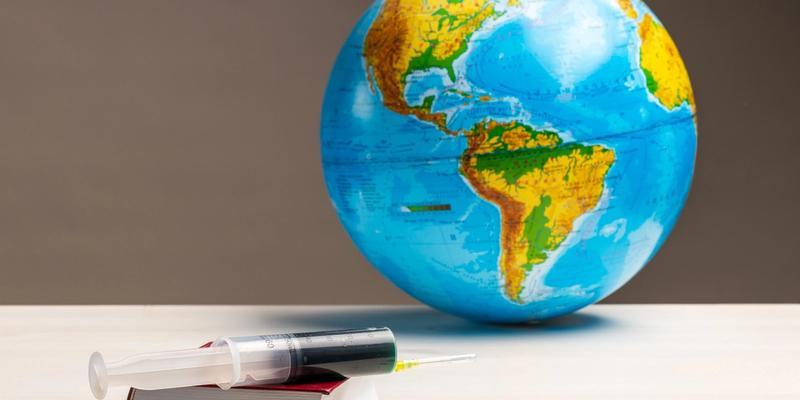 Globus, Buch und Impfspritze