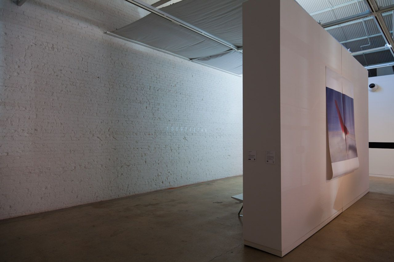 Unix Time on left hand side behind wall, untitled with steel form on right hand side