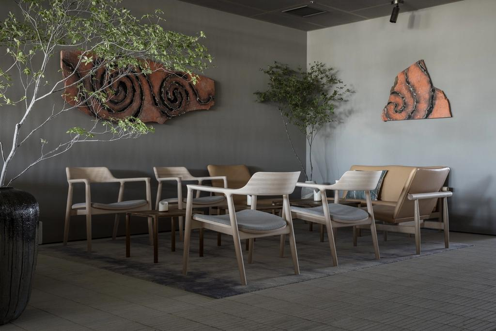 Restaurant lounge with Nikari chairs and Japan chairs on white Japanese brick floor