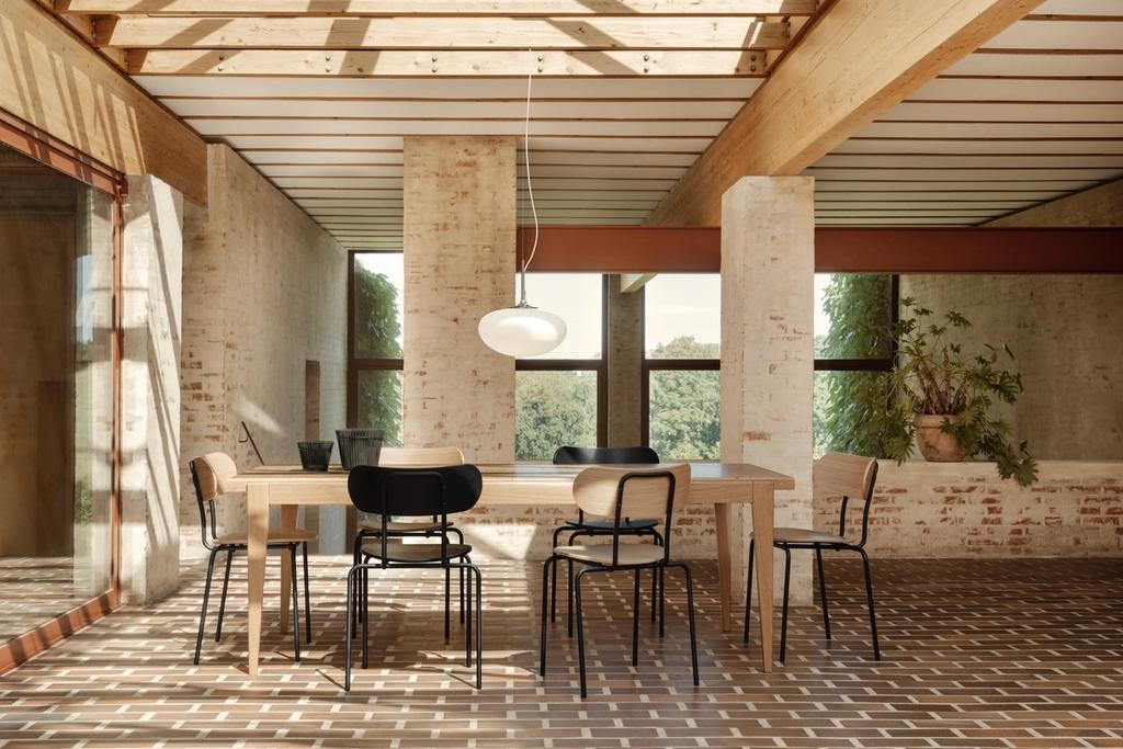 Coco stackable chair shown at Villa Hoff on birch floor